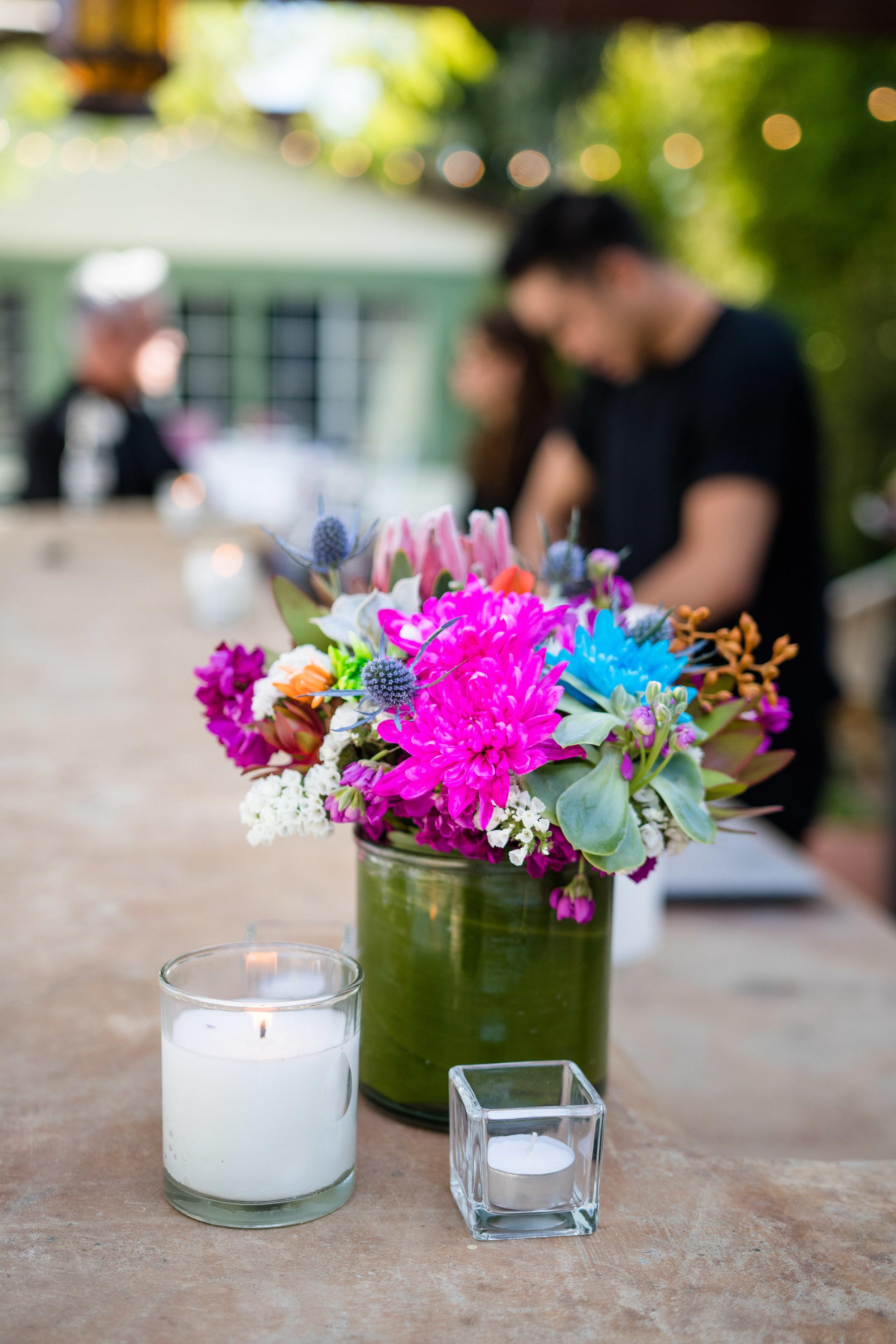 Vibrant Fiesta Backyard Wedding Reception bright pink flowers decorate the bar as well.jpg
