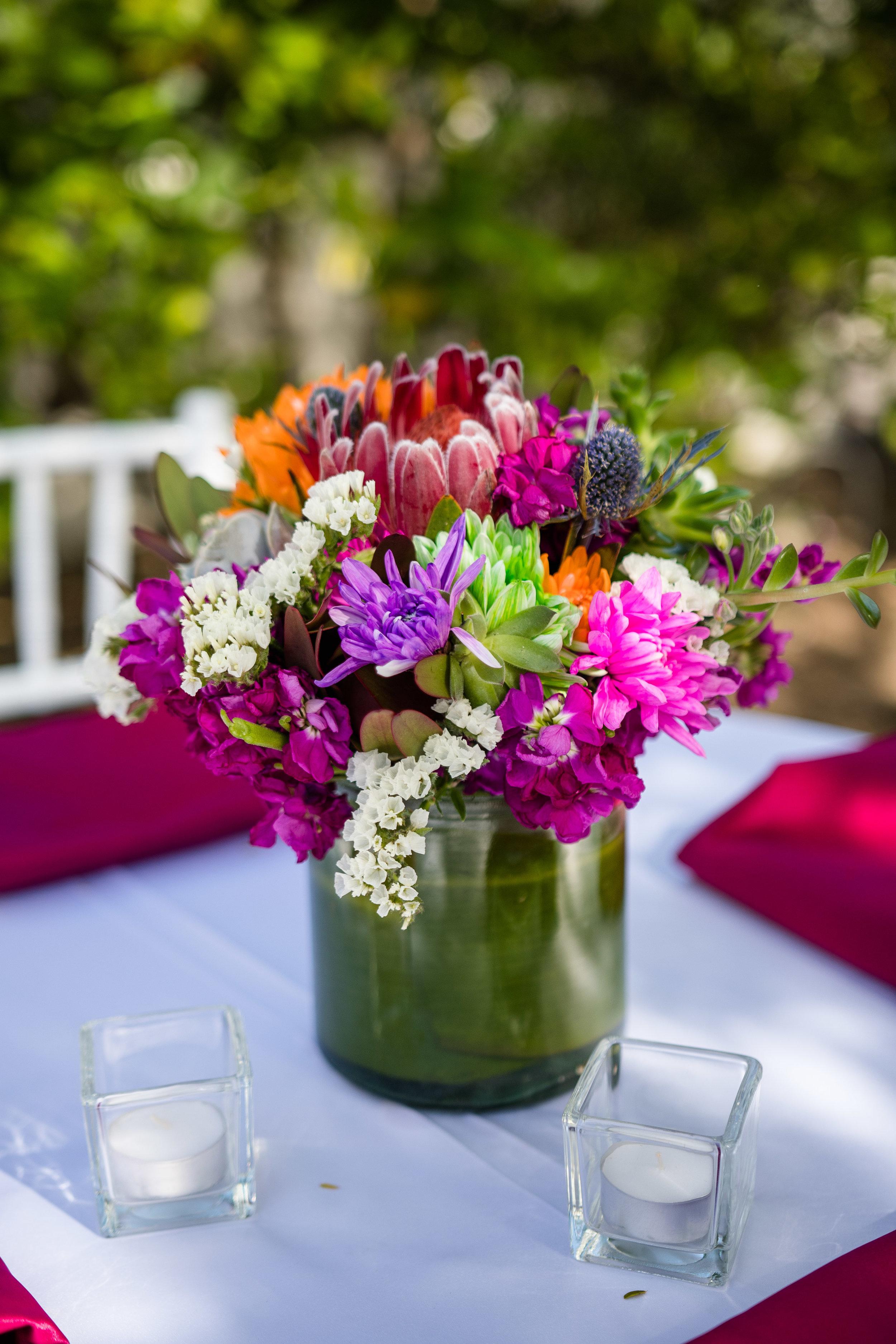 Vibrant Fiesta Backyard Wedding Reception bright spring blooms centerpieces.jpg
