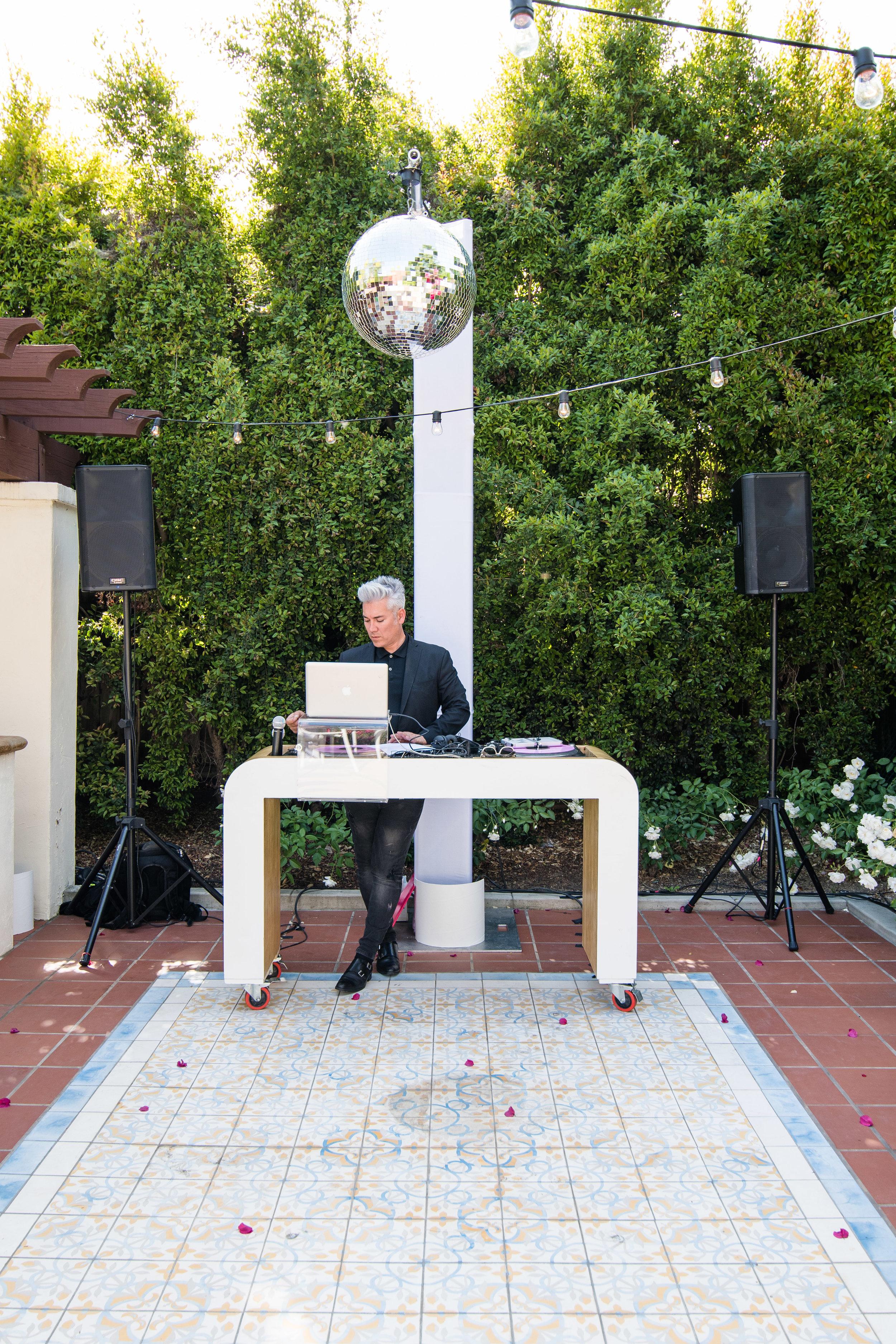 Vibrant Fiesta Backyard Wedding Reception dj herick.jpg