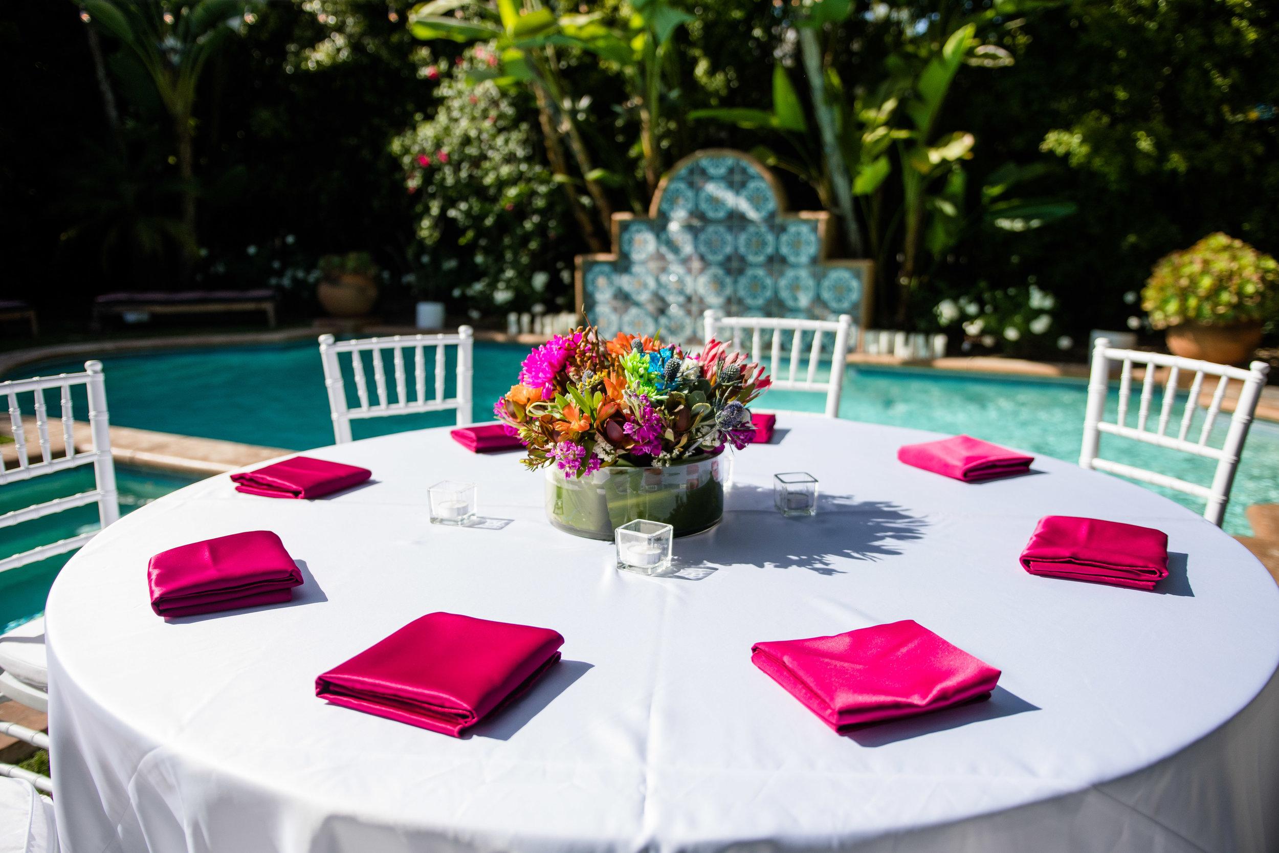 Vibrant Fiesta Backyard Wedding Reception hot pink linens and colorful centerpiece.jpg