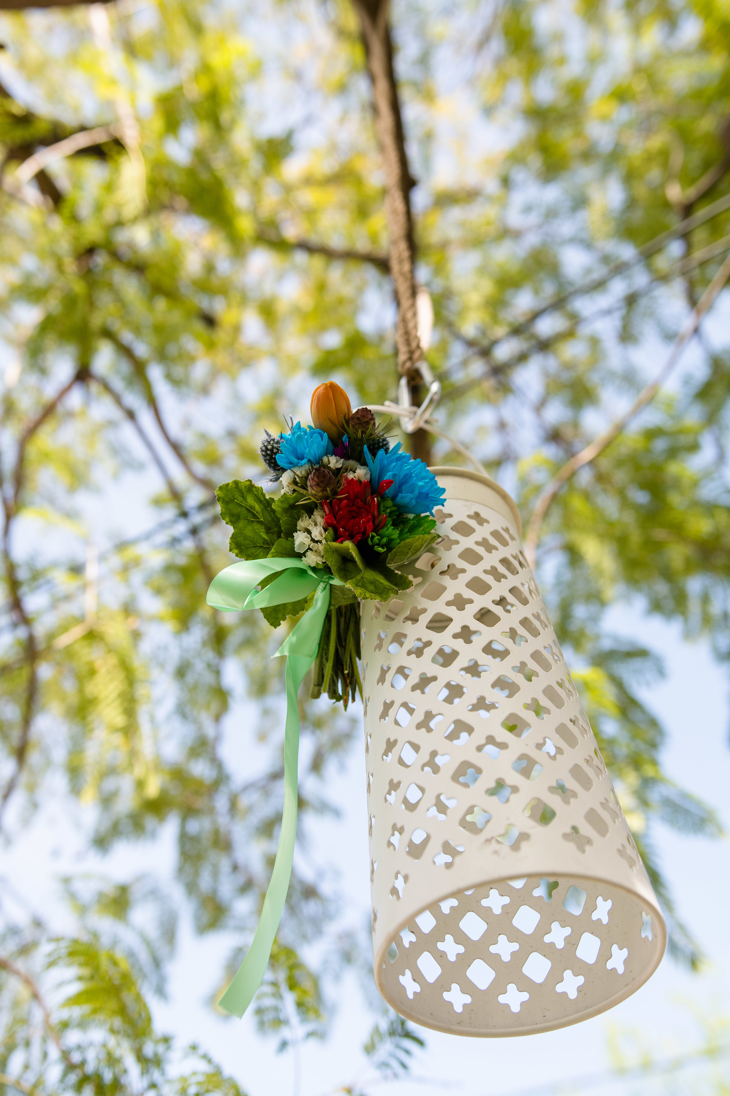Vibrant Fiesta Backyard Wedding Reception lanterns hanging from the trees.jpg