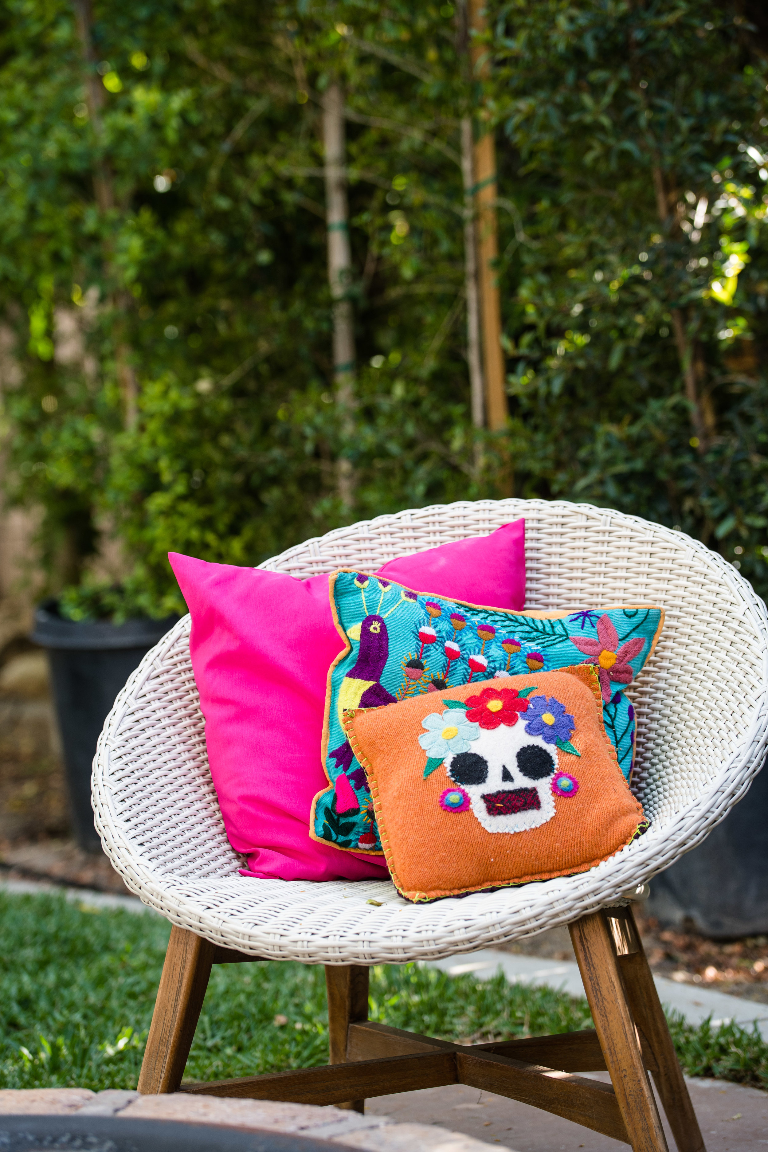 Vibrant Fiesta Backyard Wedding Reception mexican inspired pillows with hot pink accents.jpg