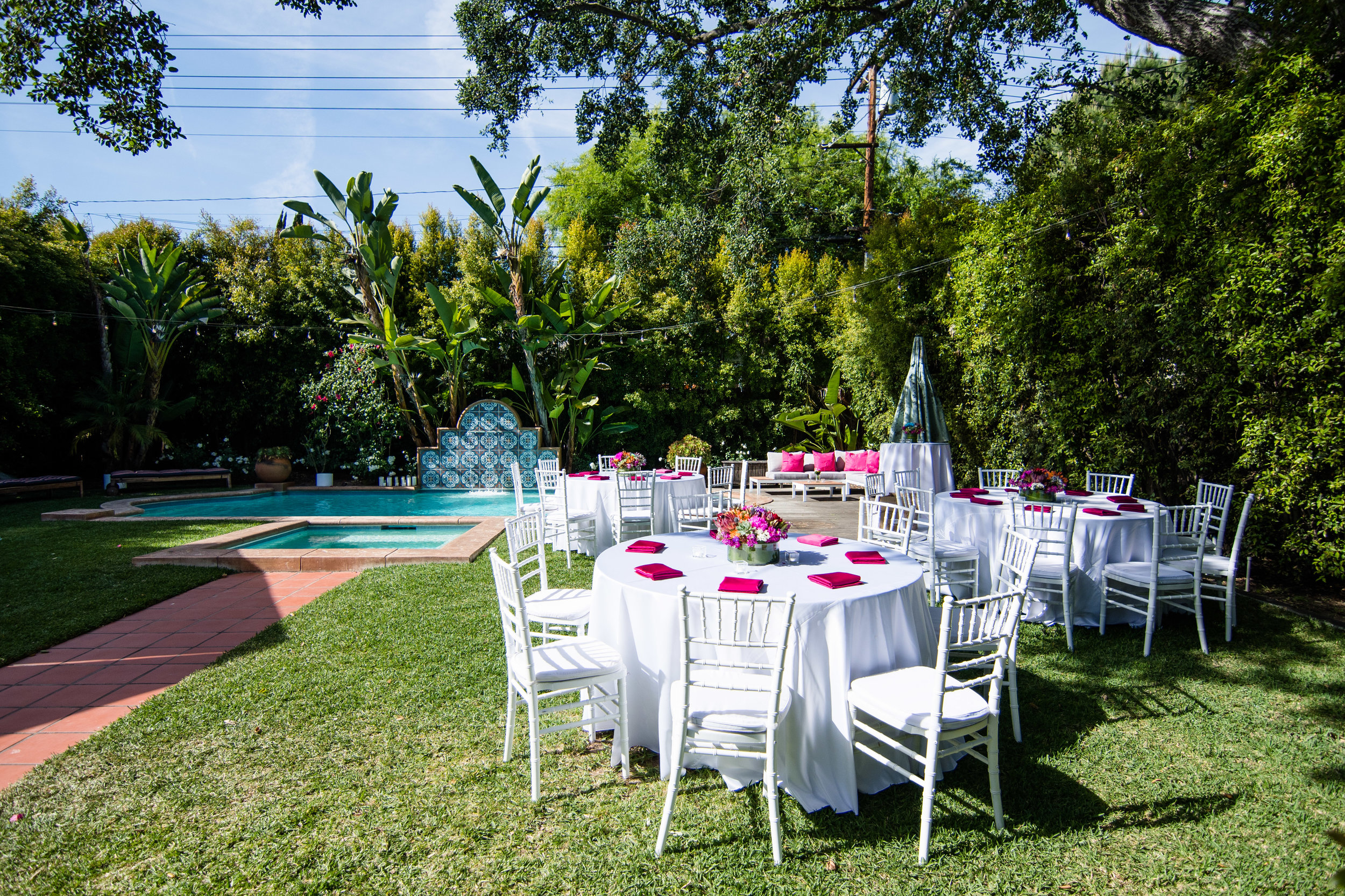 Vibrant Fiesta Backyard Wedding Reception lush greens and beautiful pool perfect wedding backdrop.jpg