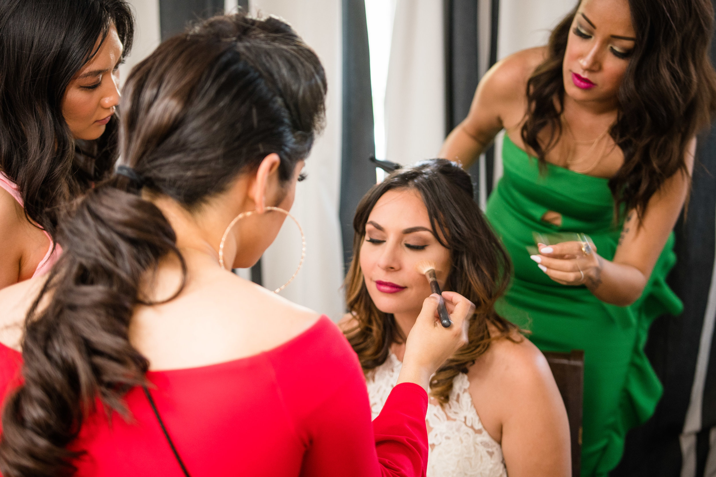 Vibrant Fiesta Backyard Wedding Reception bride getting makeup touched up before reception.jpg