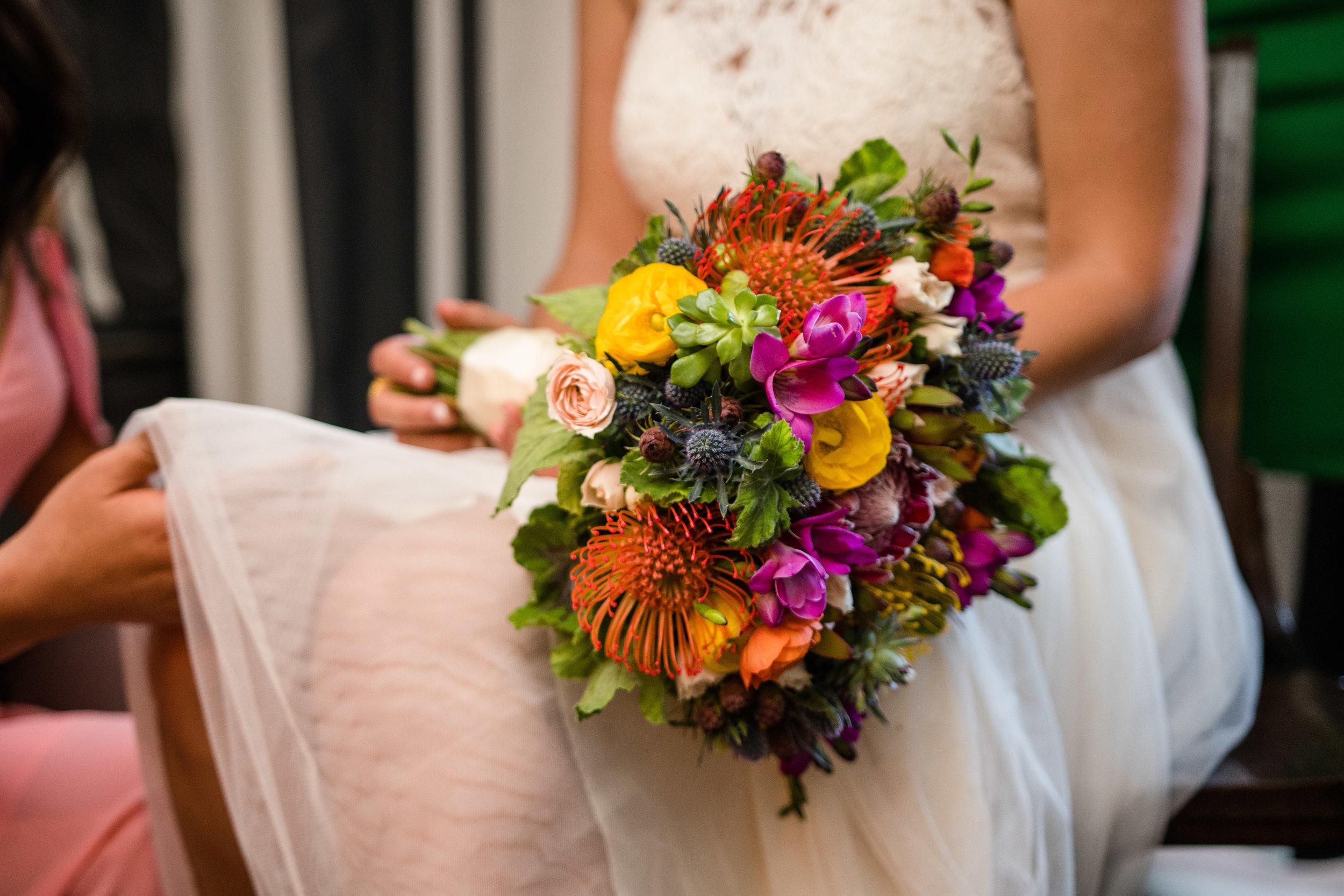 Vibrant Fiesta Backyard Wedding Reception stunning bridal bouquet.jpg
