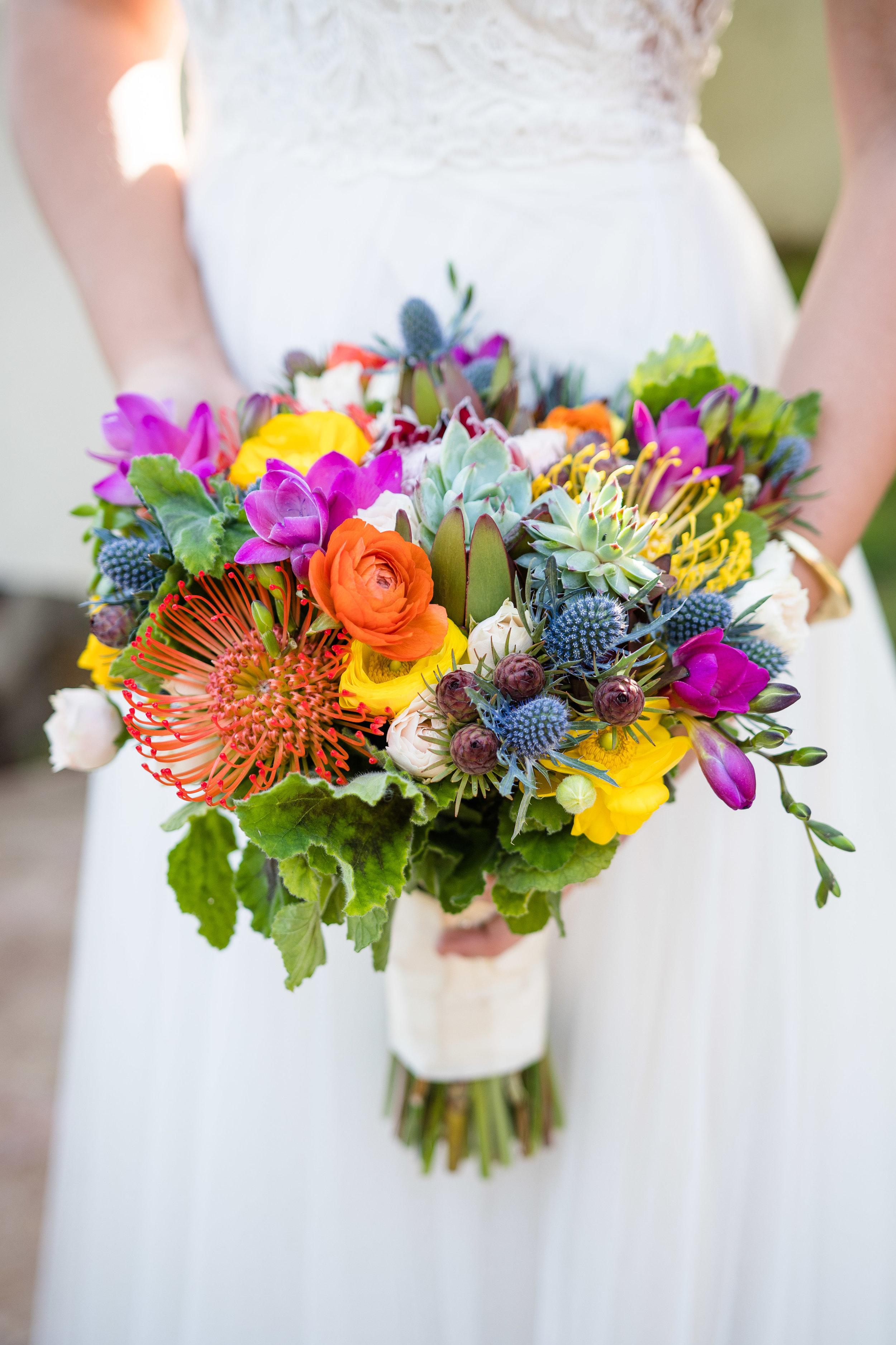Vibrant Fiesta Backyard Wedding Reception gorgeous spring blooms in bridal bouquet.jpg