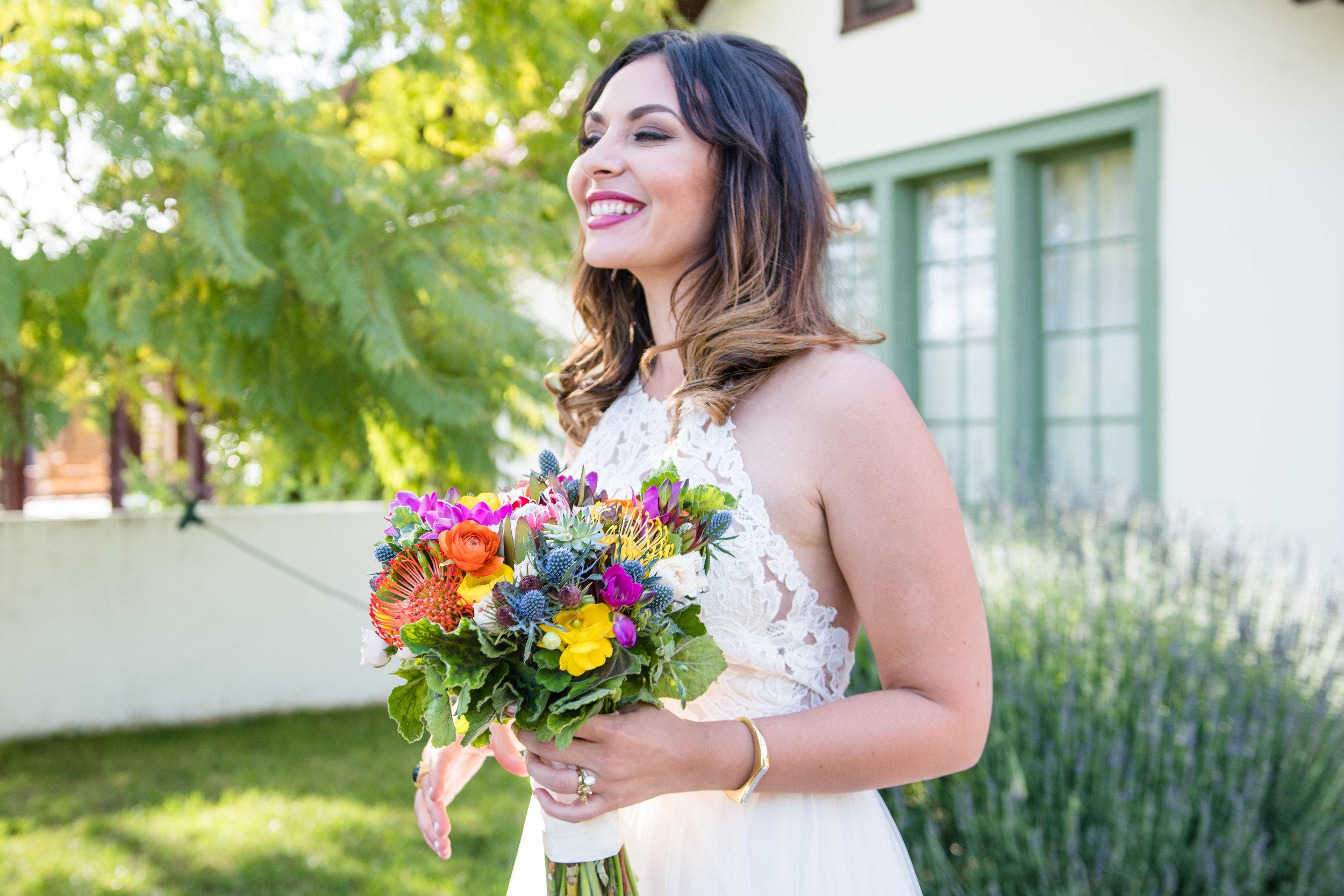 Vibrant Fiesta Backyard Wedding Reception happy bride.jpg