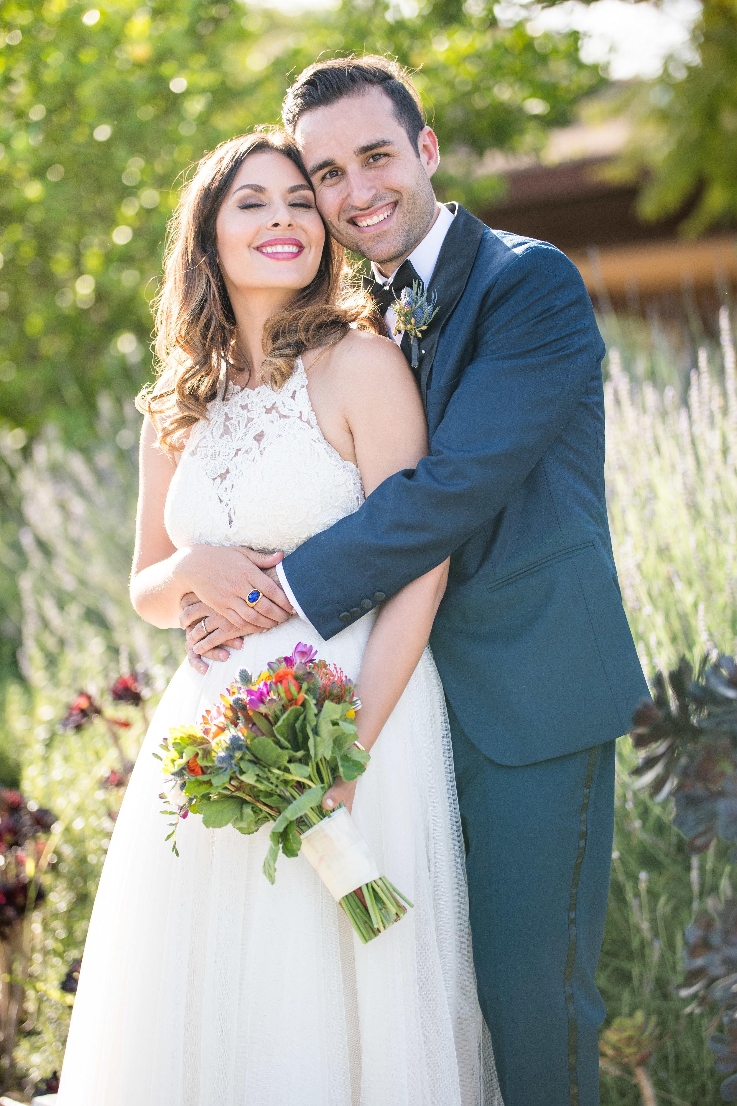 Vibrant Fiesta Backyard Wedding Reception bride and groom in flower field.jpg