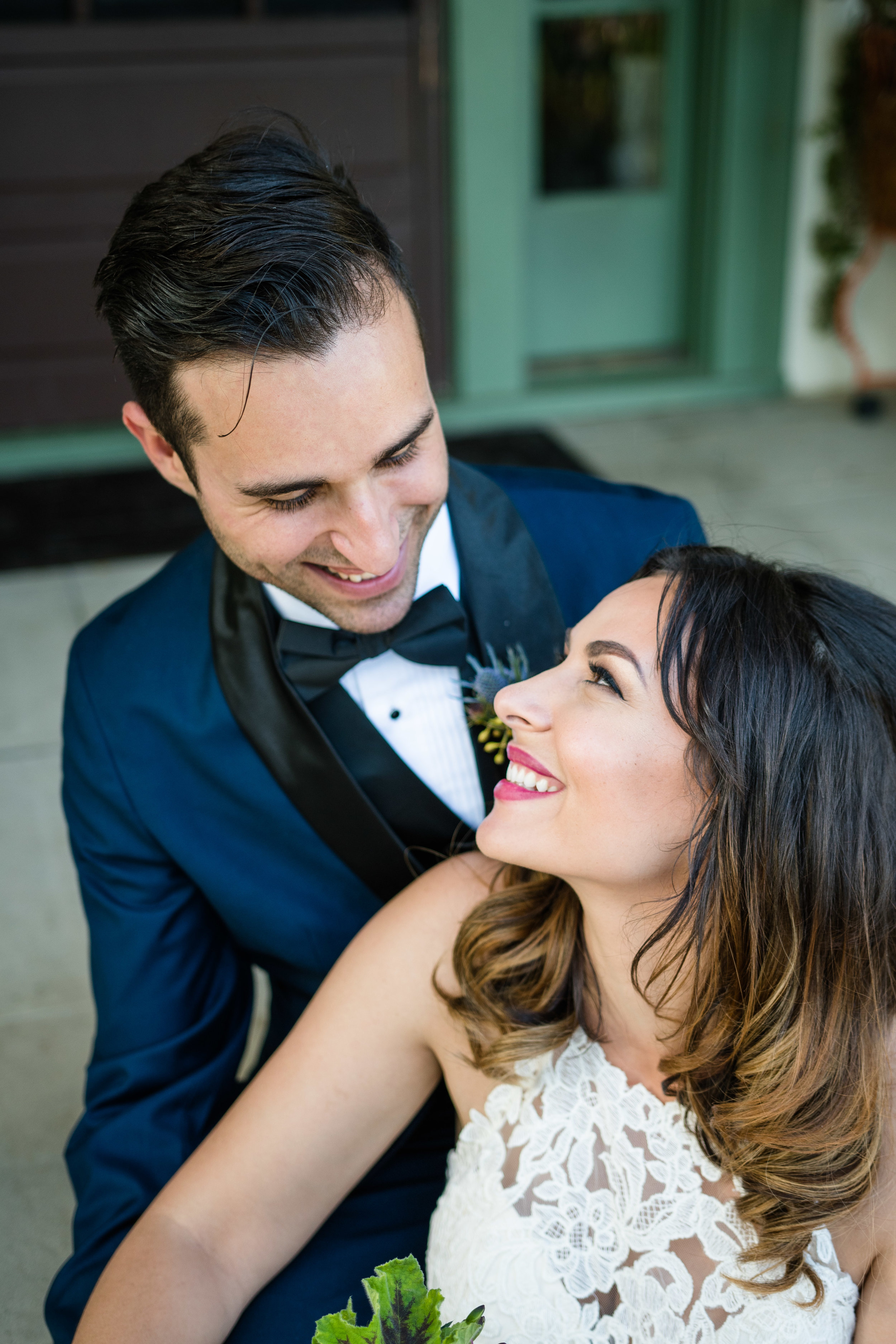 Vibrant Fiesta Backyard Wedding Reception bride looks lovingly at her new groom.jpg