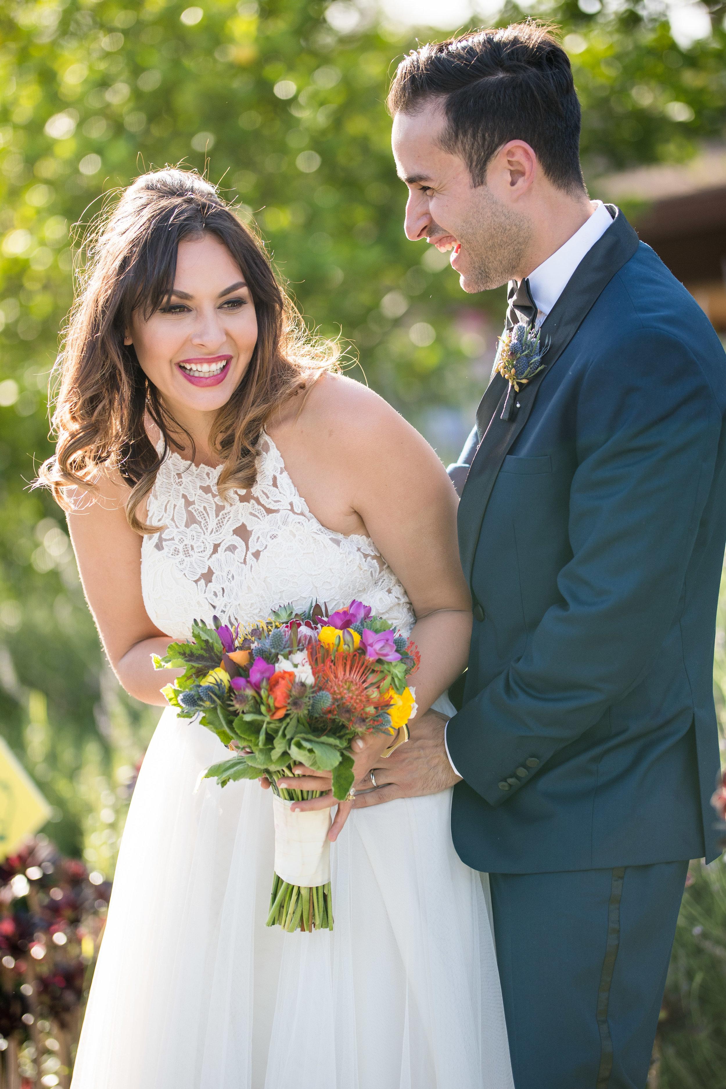 Vibrant Fiesta Backyard Wedding Reception groom making bride laugh.jpg