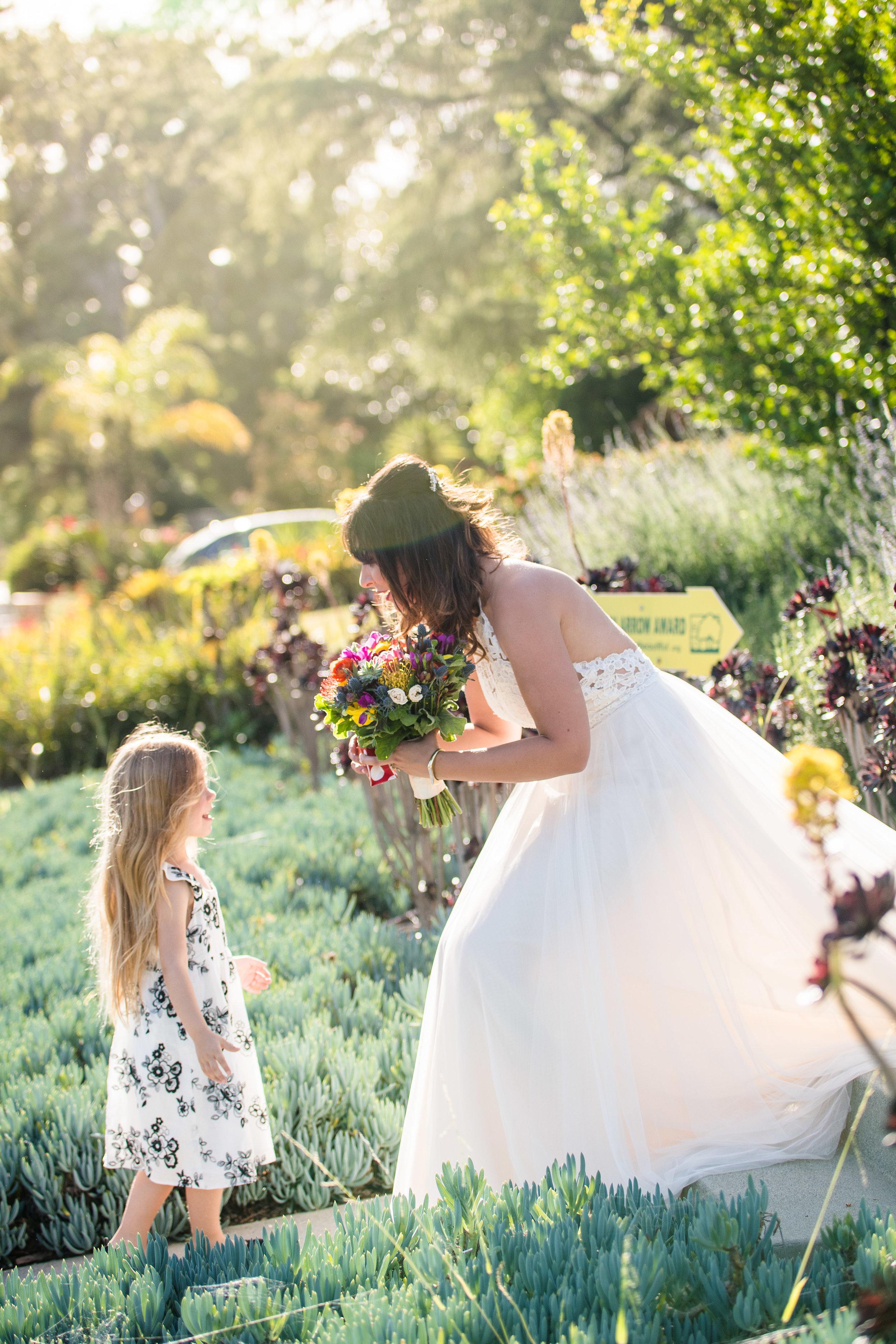 Vibrant Fiesta Backyard Wedding Reception bride with little guest.jpg