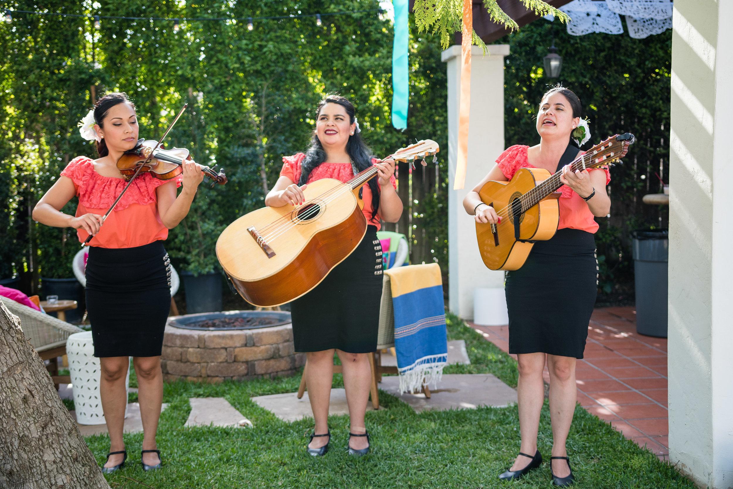 Vibrant Fiesta Backyard Wedding Reception all female mariachi band.jpg