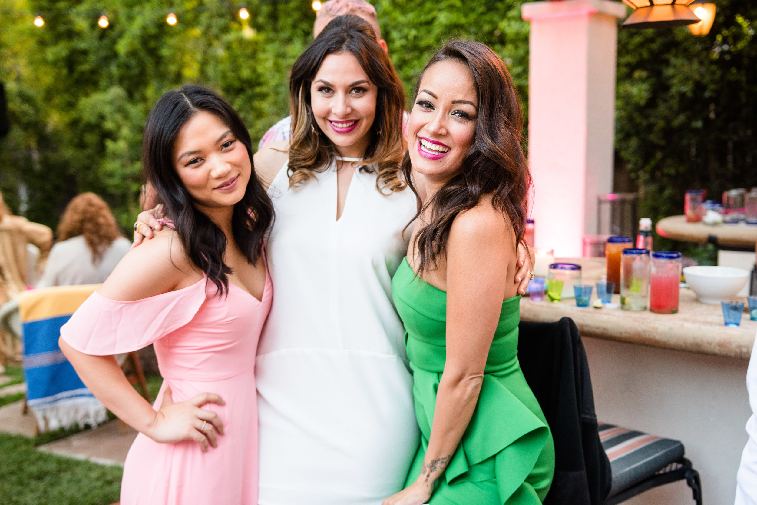 Vibrant Fiesta Backyard Wedding Reception bride and bridesmaids.jpg