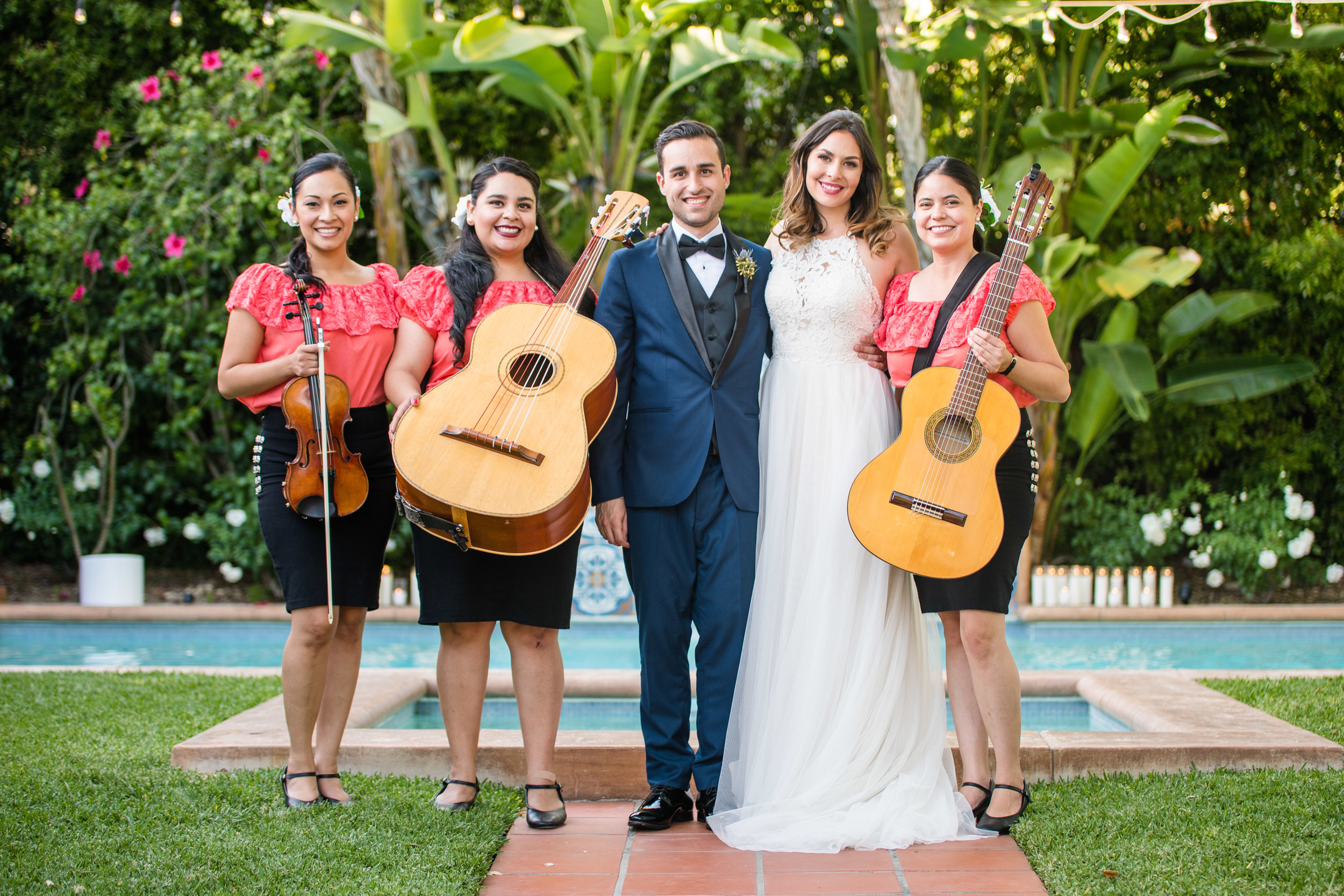 Vibrant Fiesta Backyard Wedding Reception bride and groom with mariachi band.jpg
