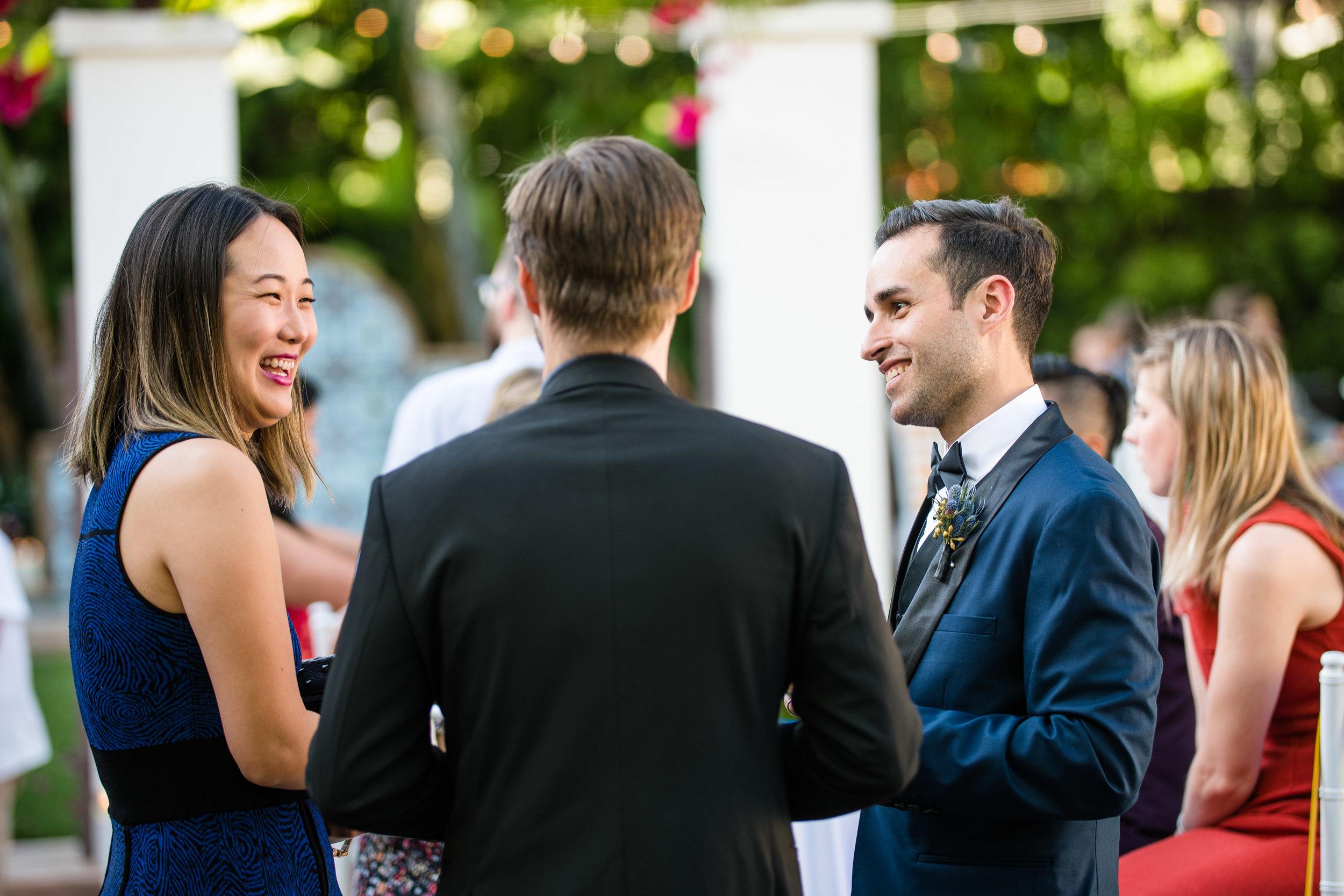 Vibrant Fiesta Backyard Wedding Reception groom entertaining guests.jpg