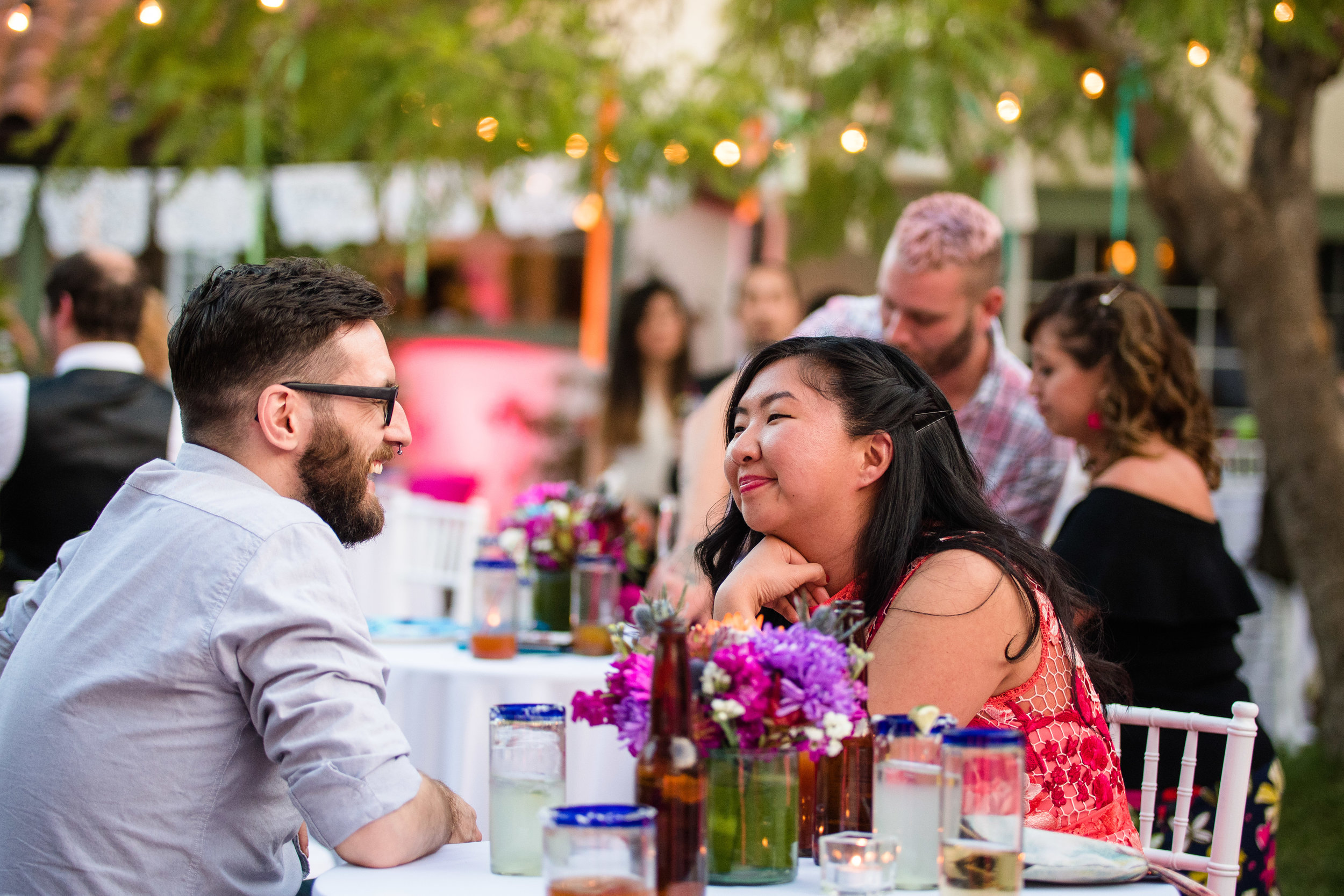 Vibrant Fiesta Backyard Wedding Reception guests enjoying the beautiful evening.jpg