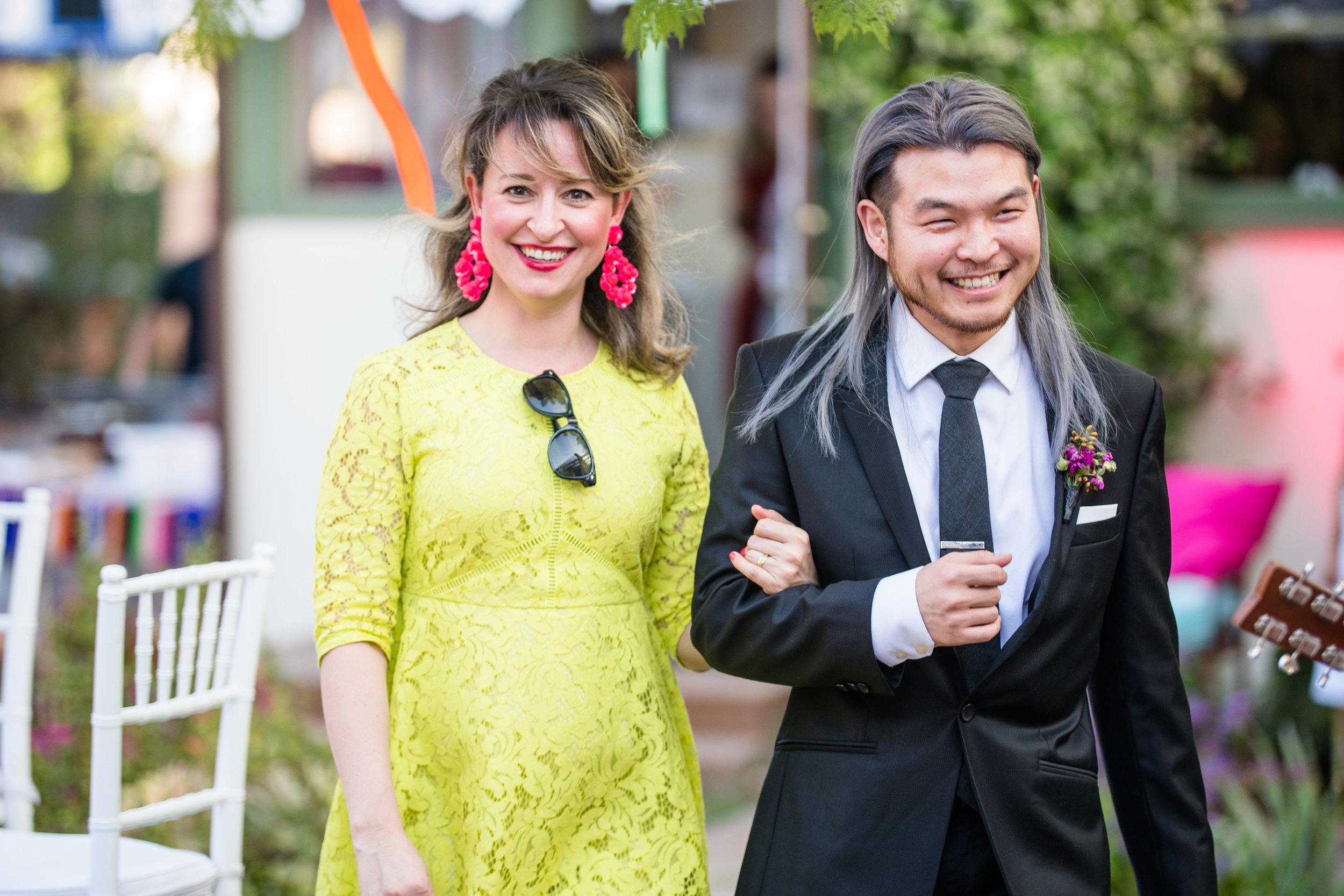 Vibrant Fiesta Backyard Wedding Reception bridesmaid in lime.jpg