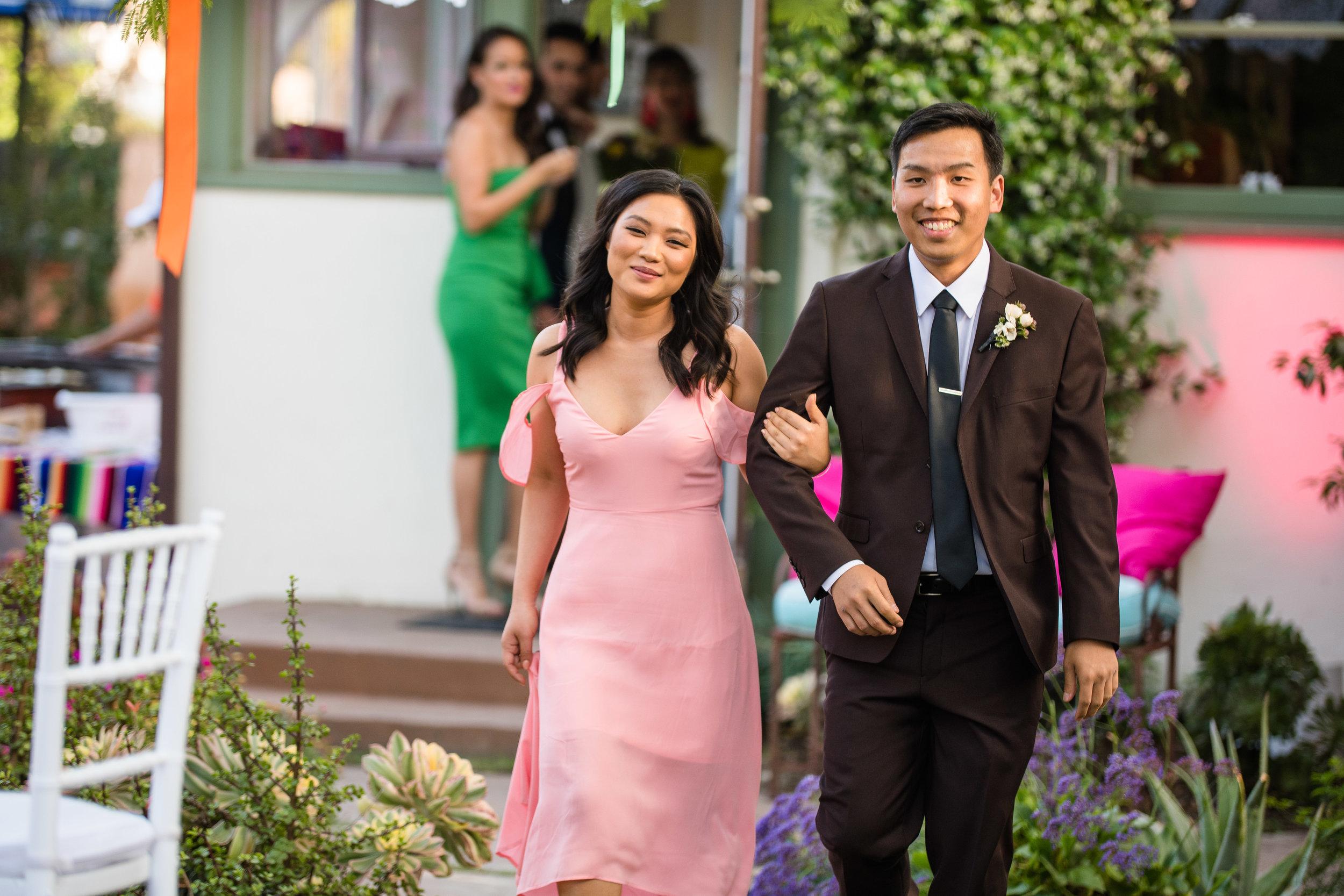 Vibrant Fiesta Backyard Wedding Reception bridesmaid in pink.jpg