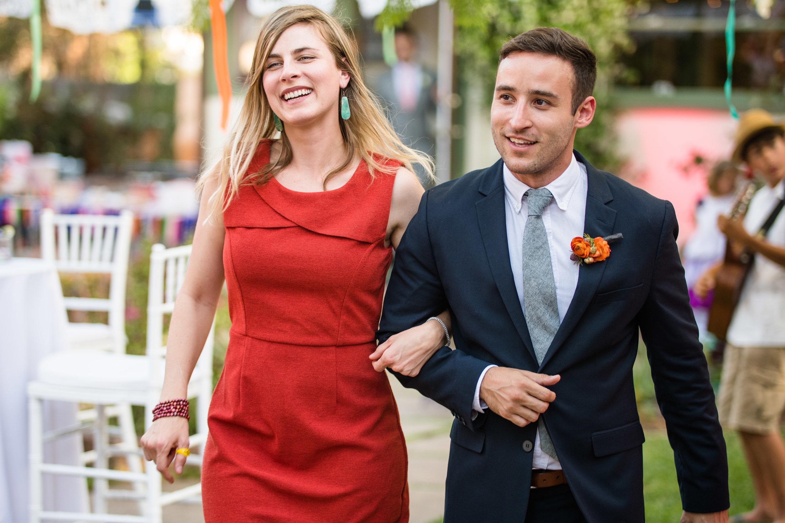Vibrant Fiesta Backyard Wedding Reception bridesmaid in red.jpg