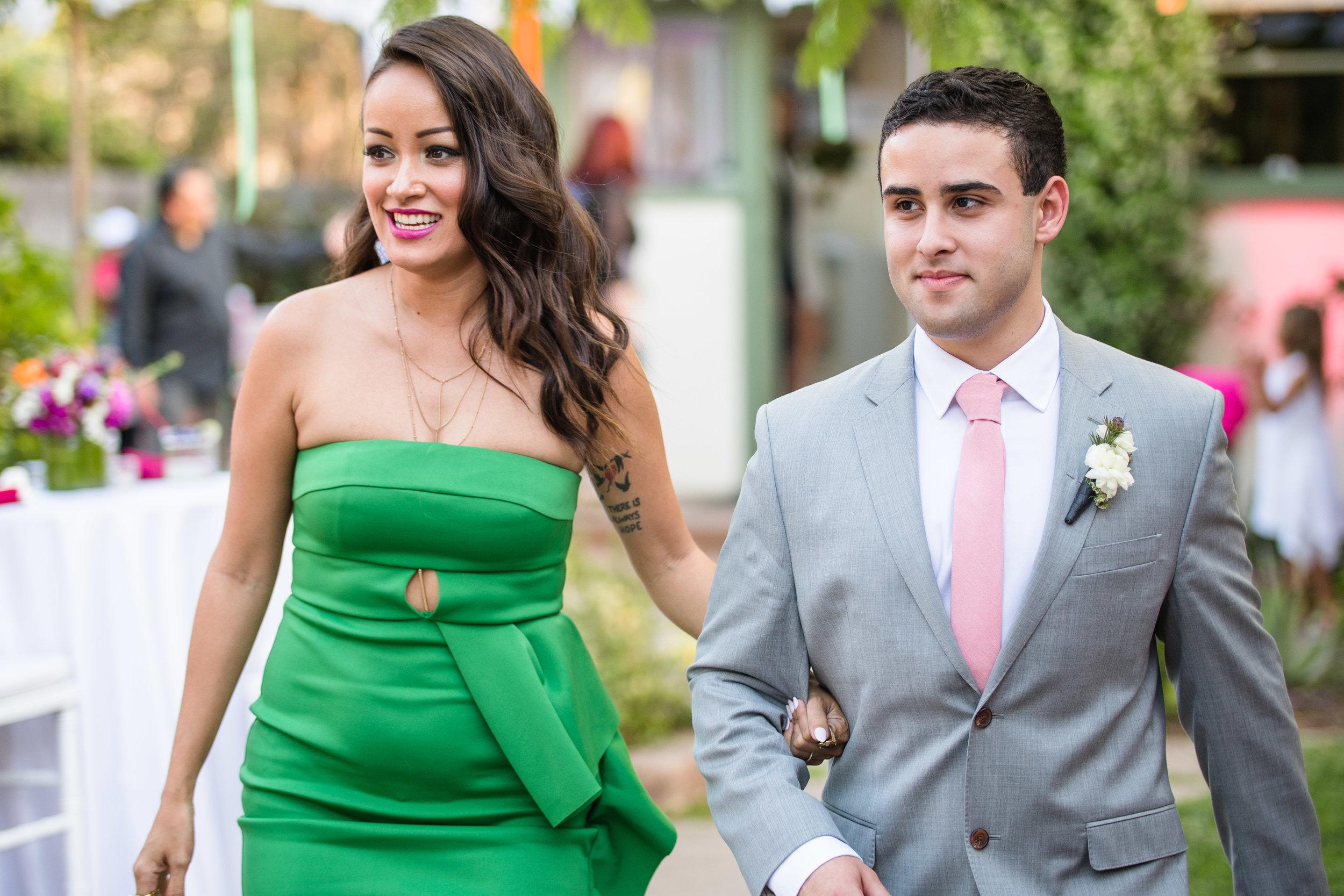 Vibrant Fiesta Backyard Wedding Reception matron of honor in green.jpg