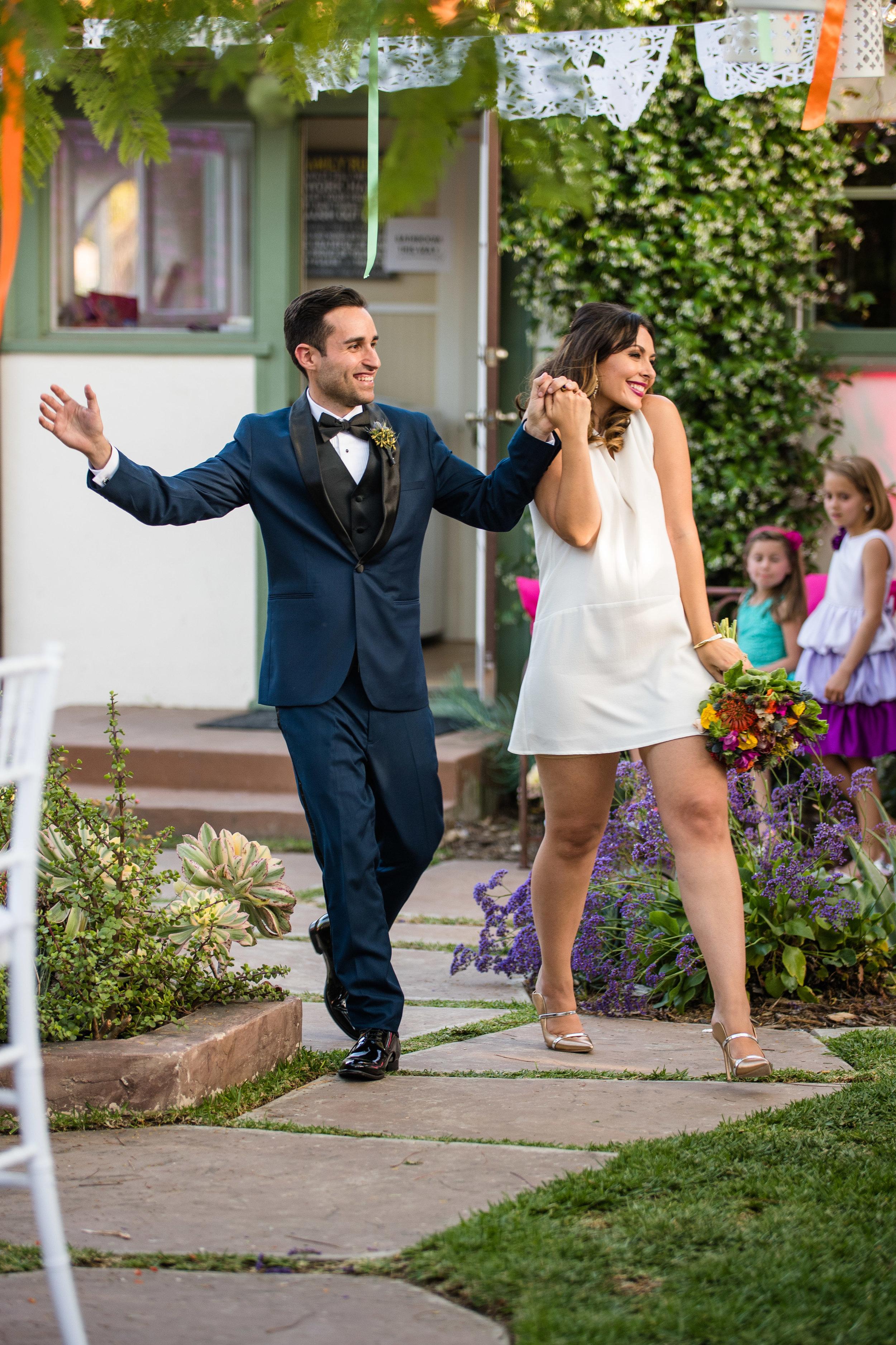 Vibrant Fiesta Backyard Wedding Reception bride and groom enter reception.jpg