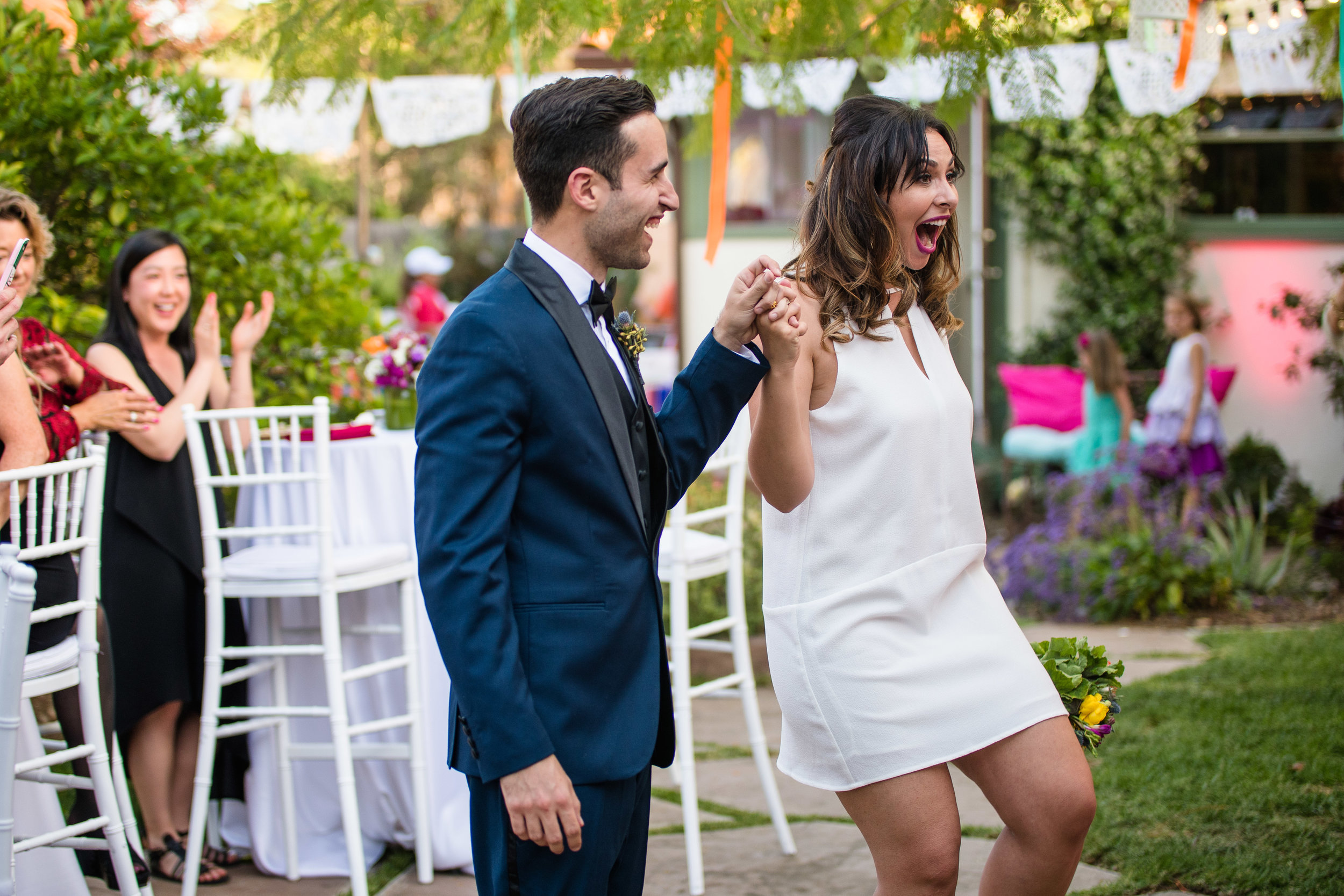 Vibrant Fiesta Backyard Wedding Reception bride happy to see family and friends.jpg