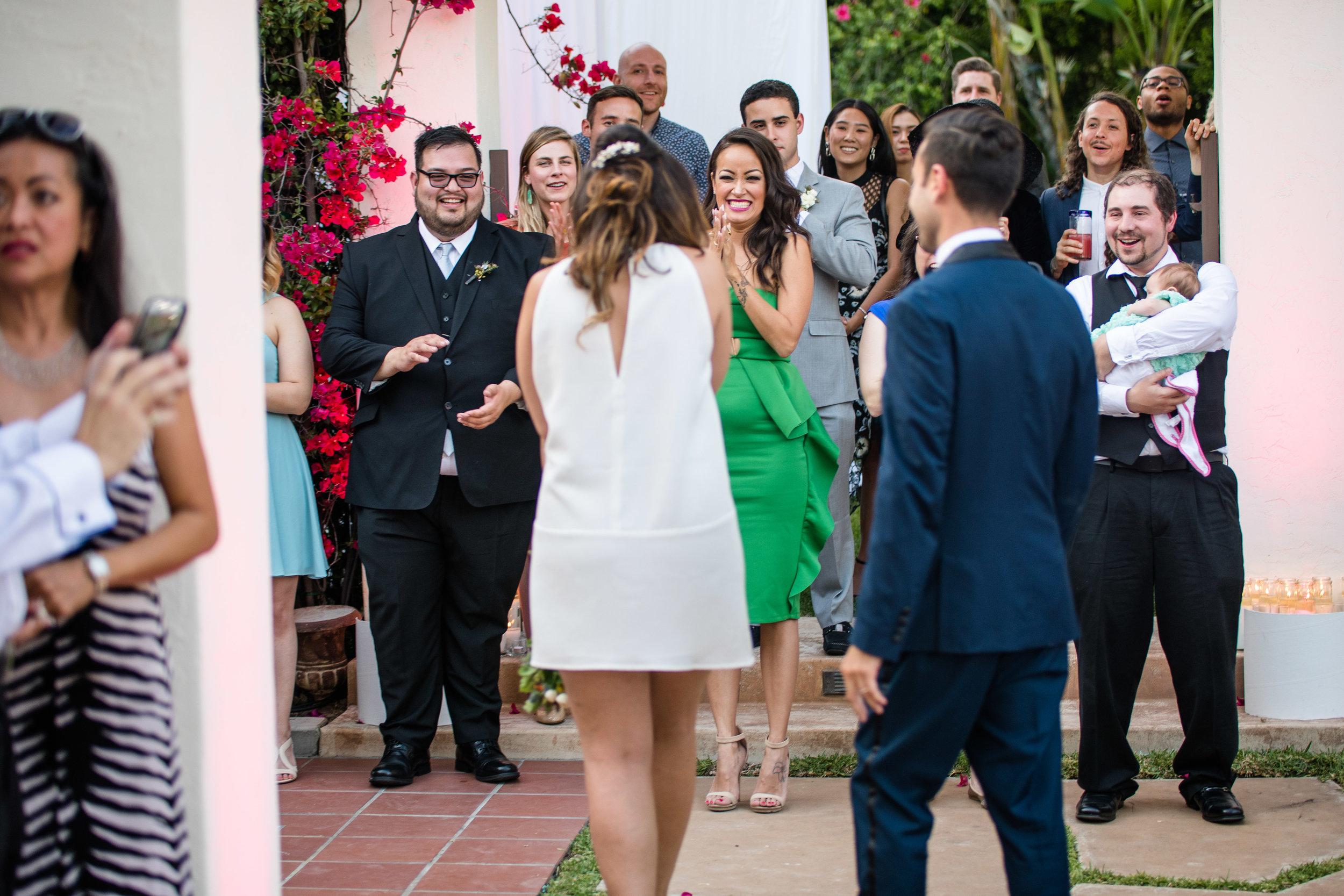 Vibrant Fiesta Backyard Wedding Reception bride overwhelmed by family and friends.jpg