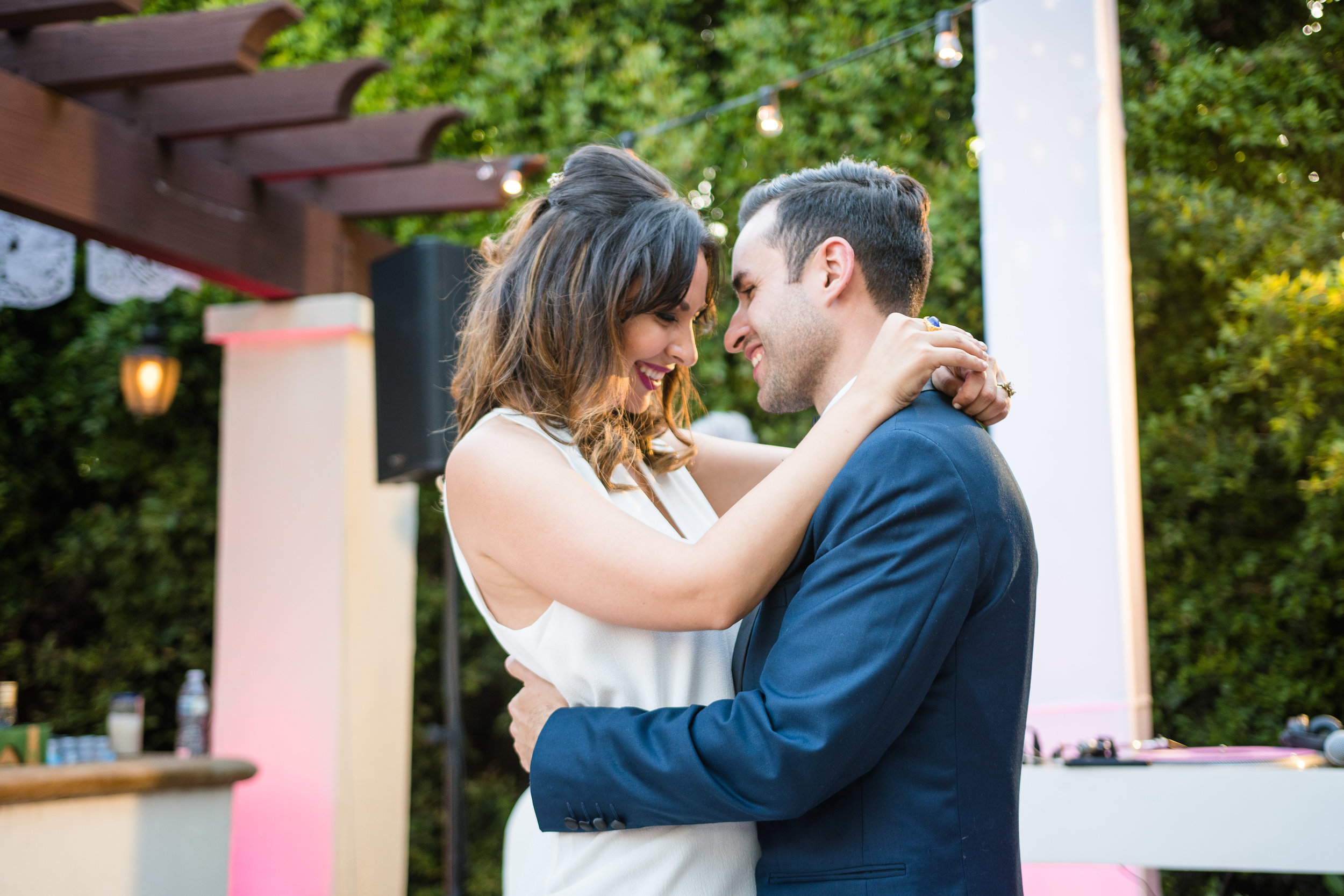 Vibrant Fiesta Backyard Wedding Reception bride so happy in love first dance.jpg