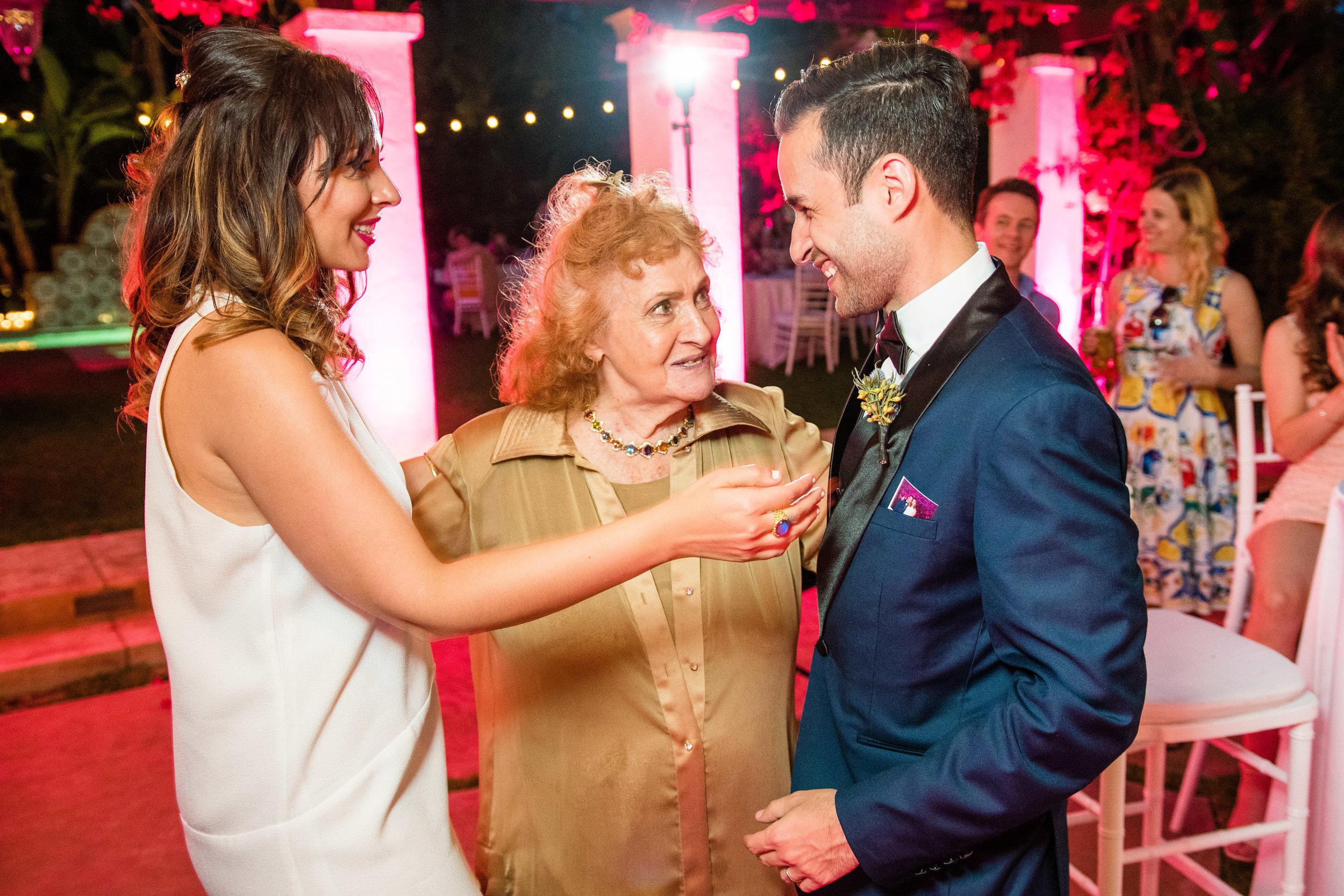 Vibrant Fiesta Backyard Wedding Reception grandmother with bride and groom.jpg