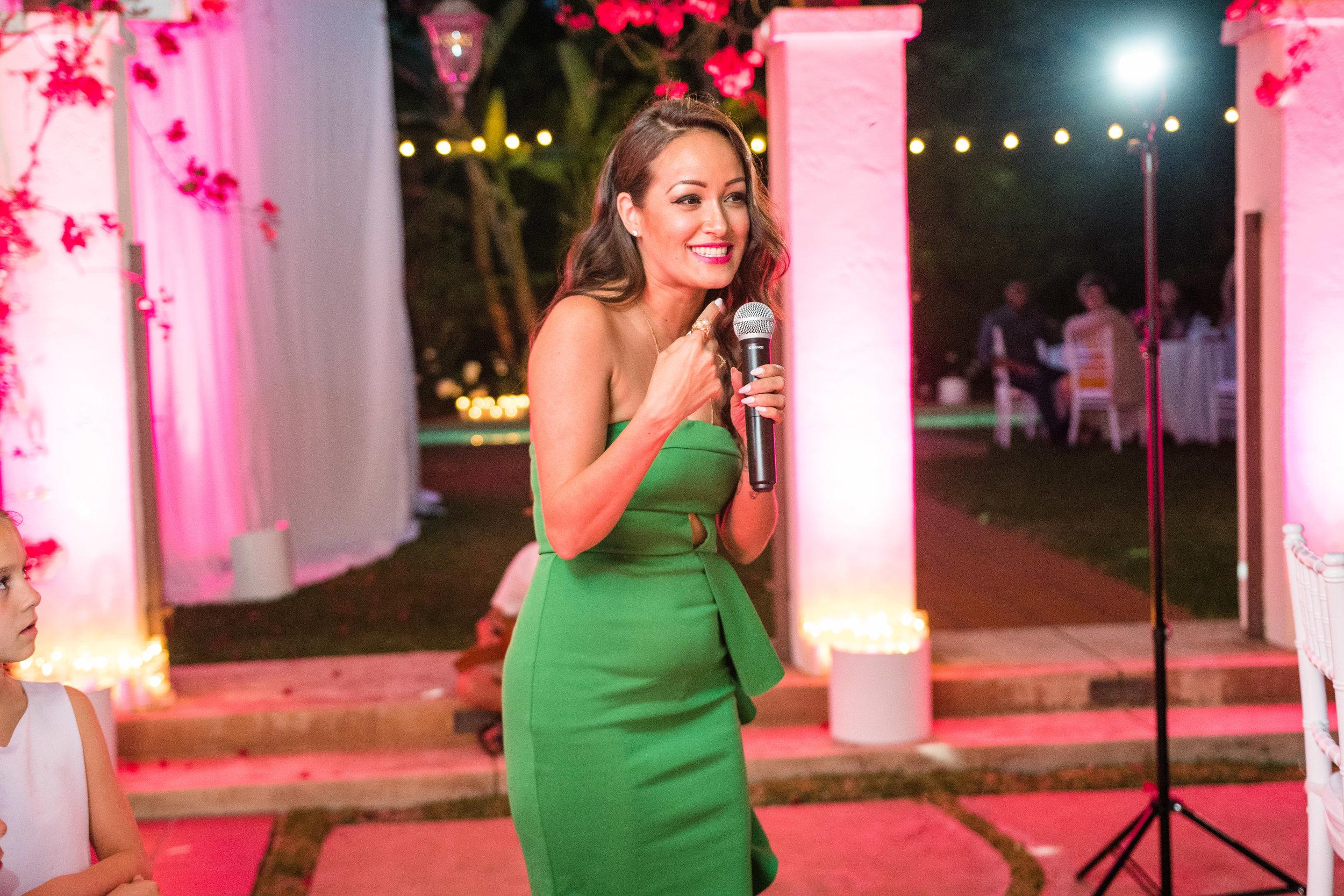 Vibrant Fiesta Backyard Wedding Reception matron of honor making a toast.jpg