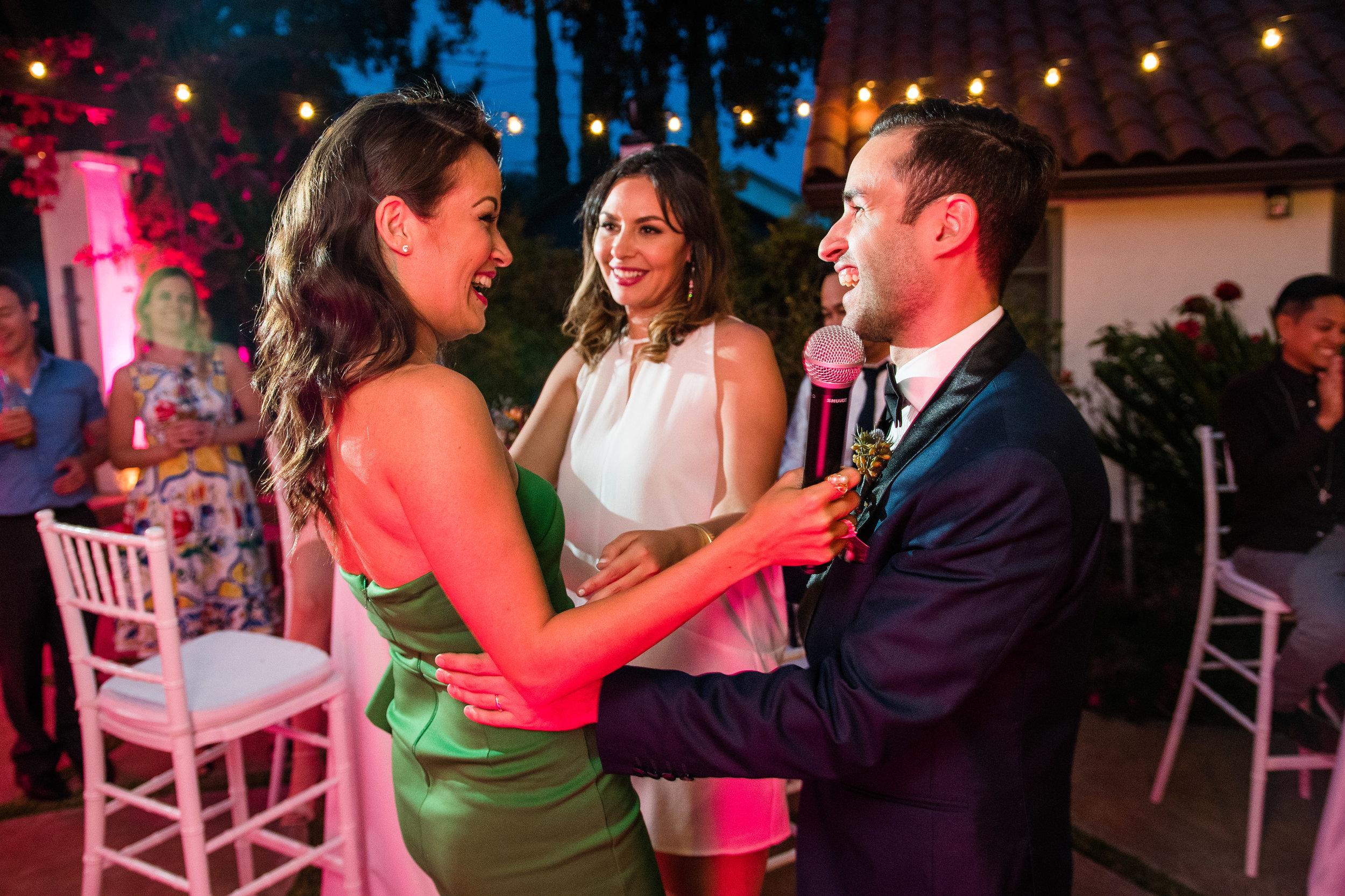 Vibrant Fiesta Backyard Wedding Reception matron of honor with bride and groom.jpg