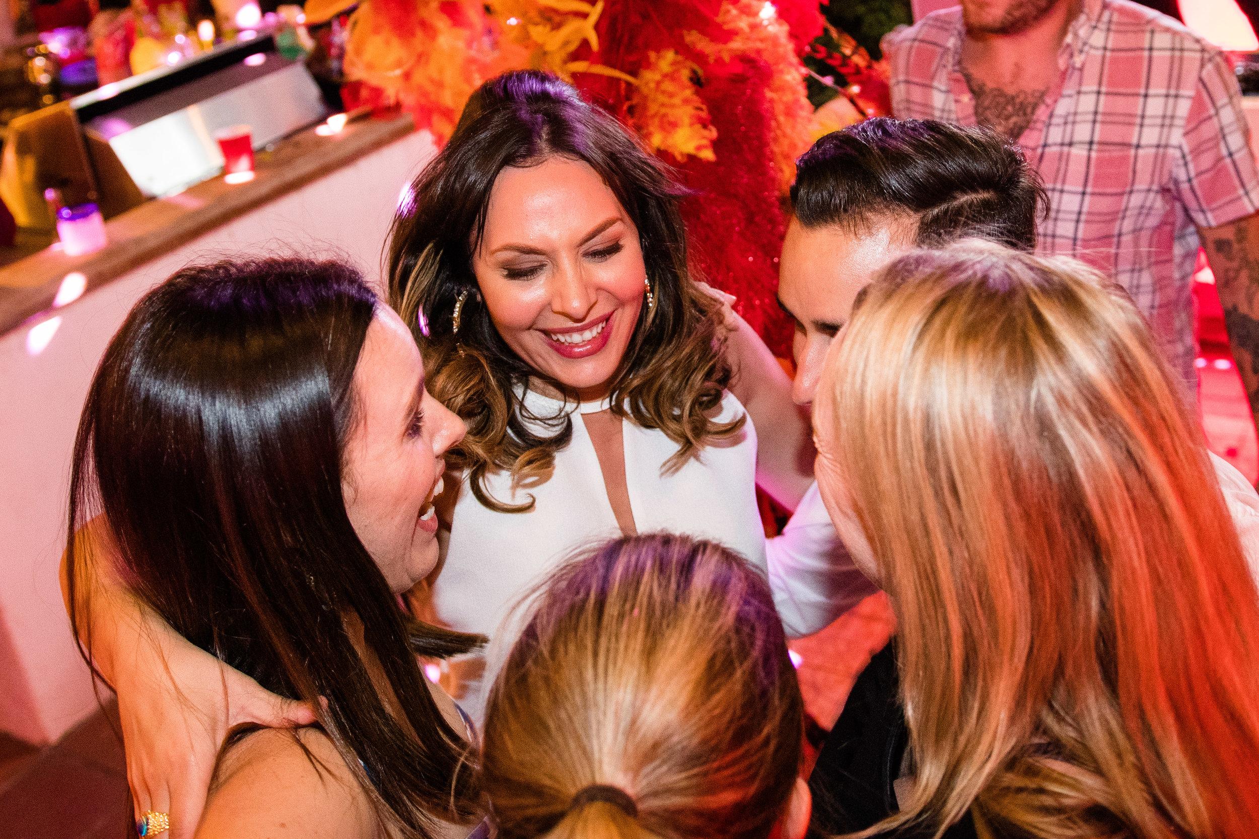 Vibrant Fiesta Backyard Wedding Reception bride and circle friends.jpg