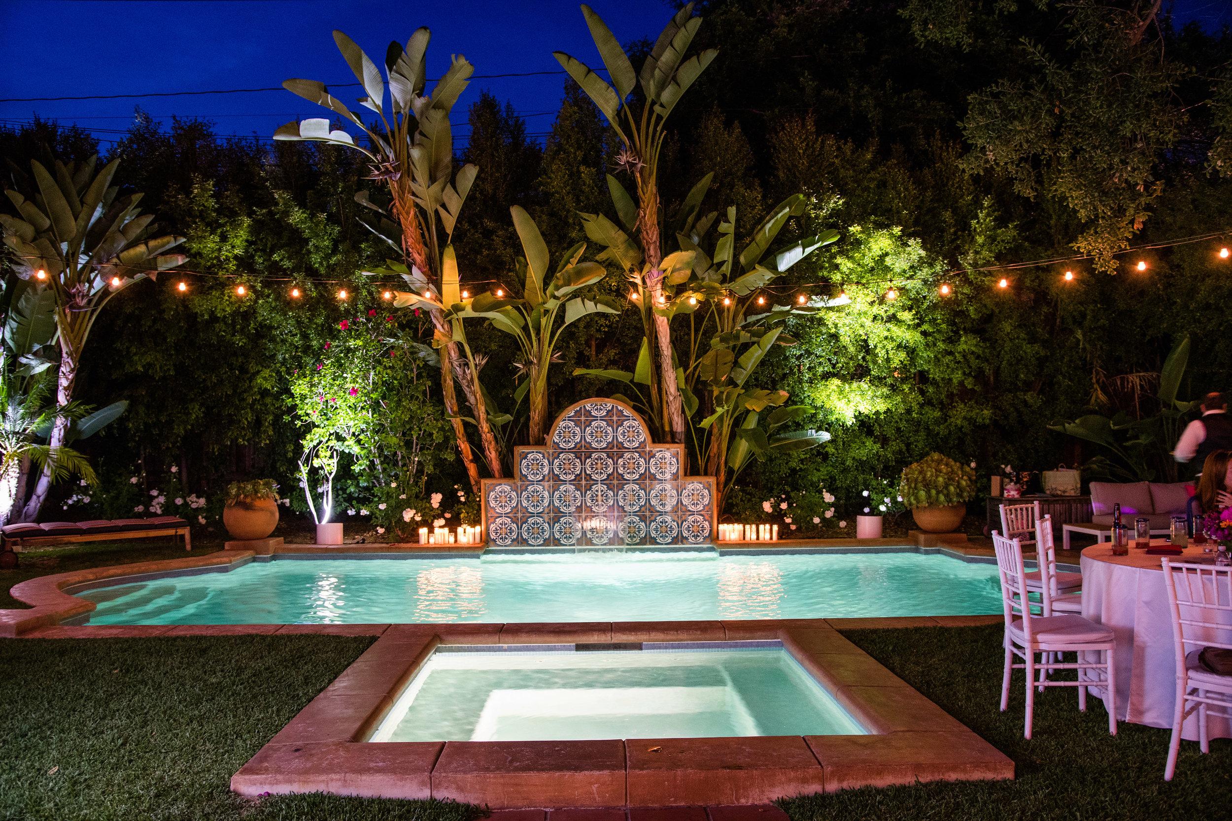 Vibrant Fiesta Backyard Wedding Reception evening pool.jpg
