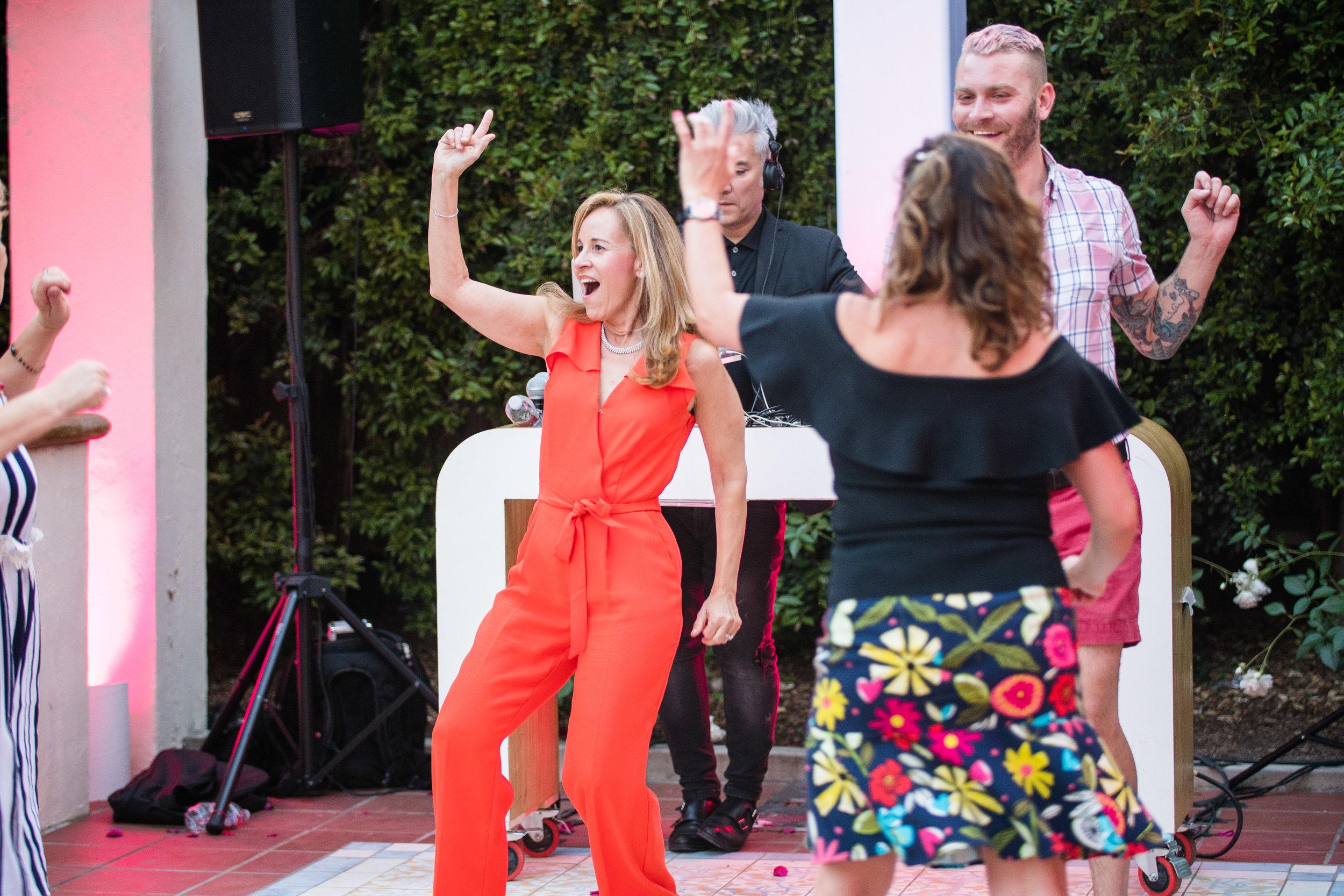 Vibrant Fiesta Backyard Wedding Reception guests enjoying the music.jpg