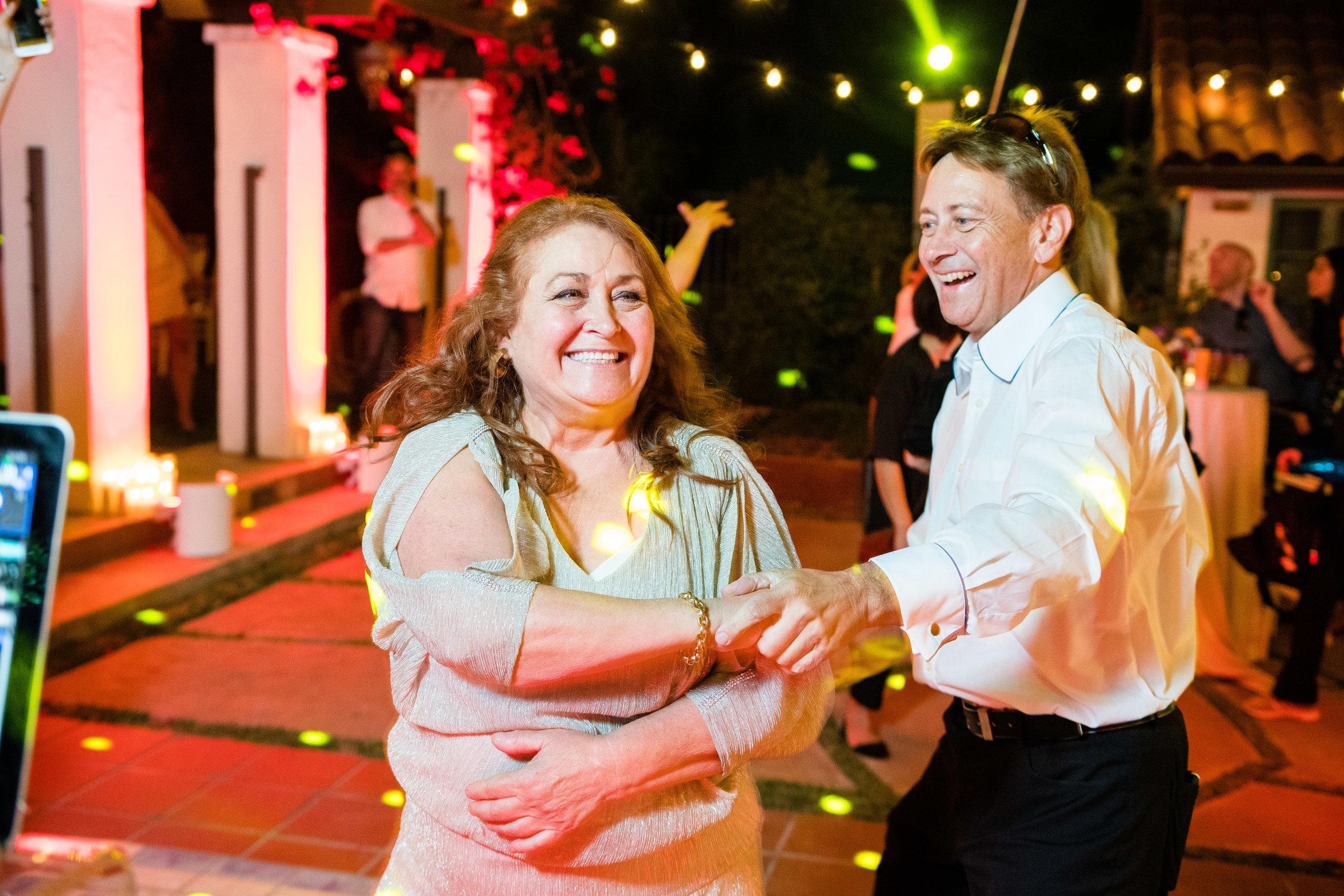 Vibrant Fiesta Backyard Wedding Reception mother of bride dancing.jpg