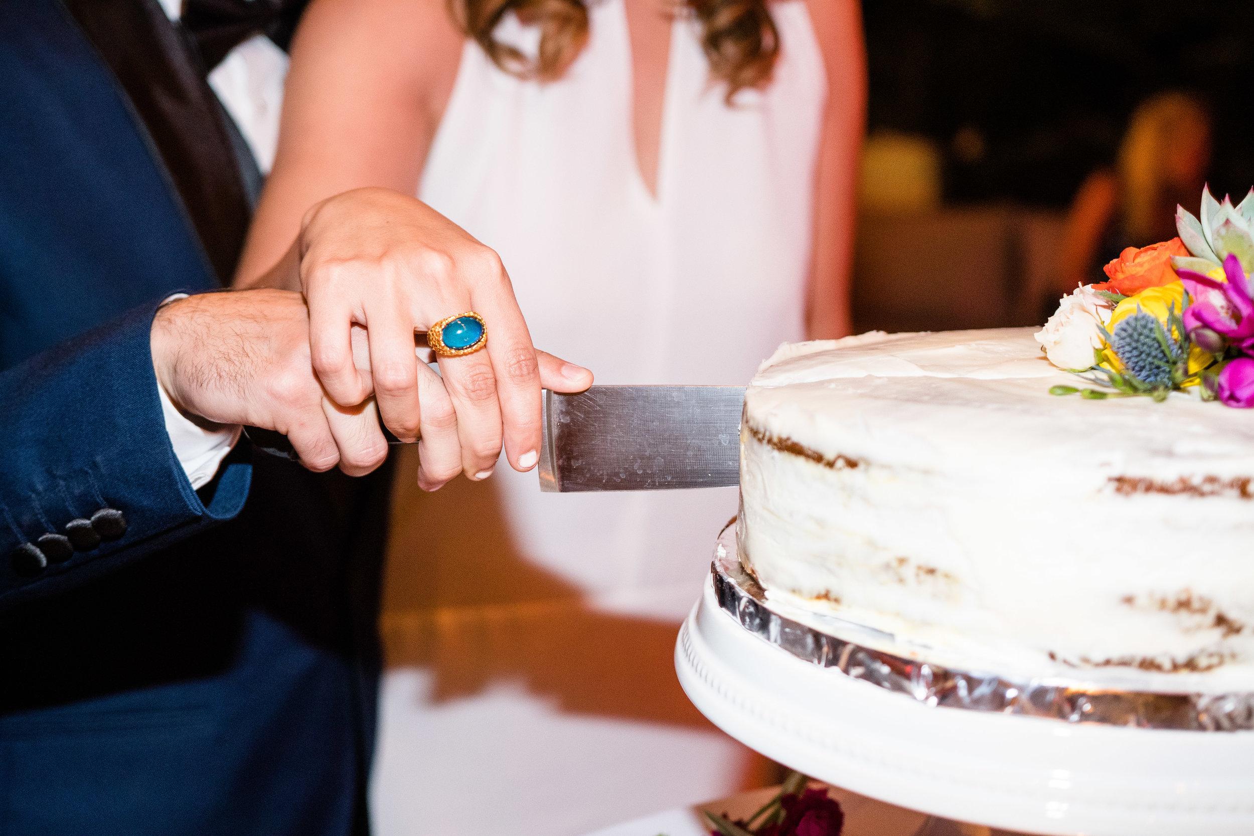 Vibrant Fiesta Backyard Wedding Reception cake cutting.jpg