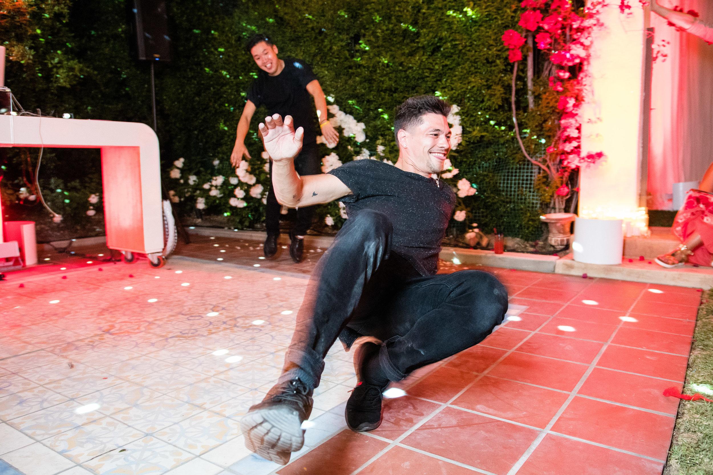 Vibrant Fiesta Backyard Wedding Reception break dancers having fun at reception.jpg