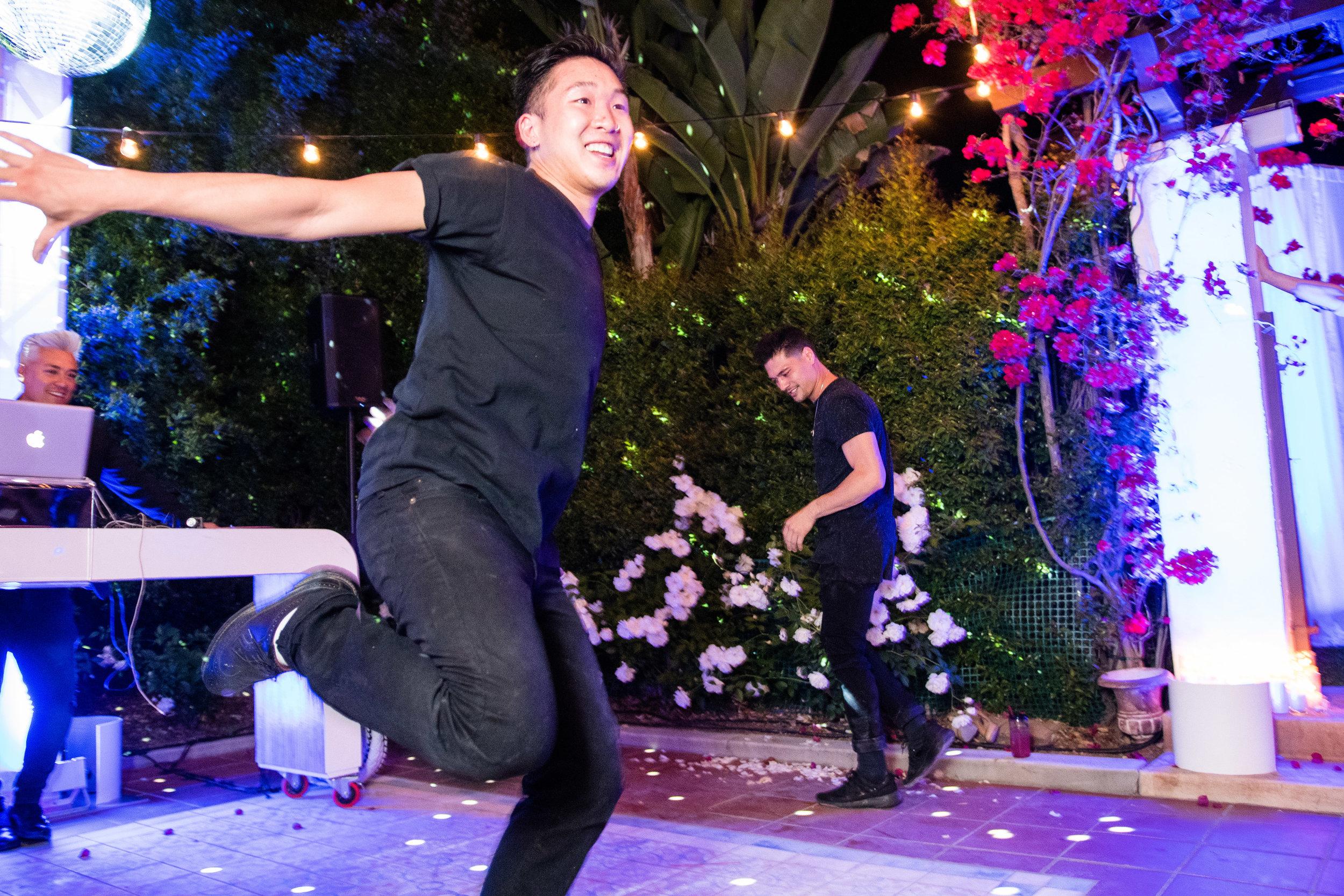 Vibrant Fiesta Backyard Wedding Reception break dancers on the dance floor.jpg