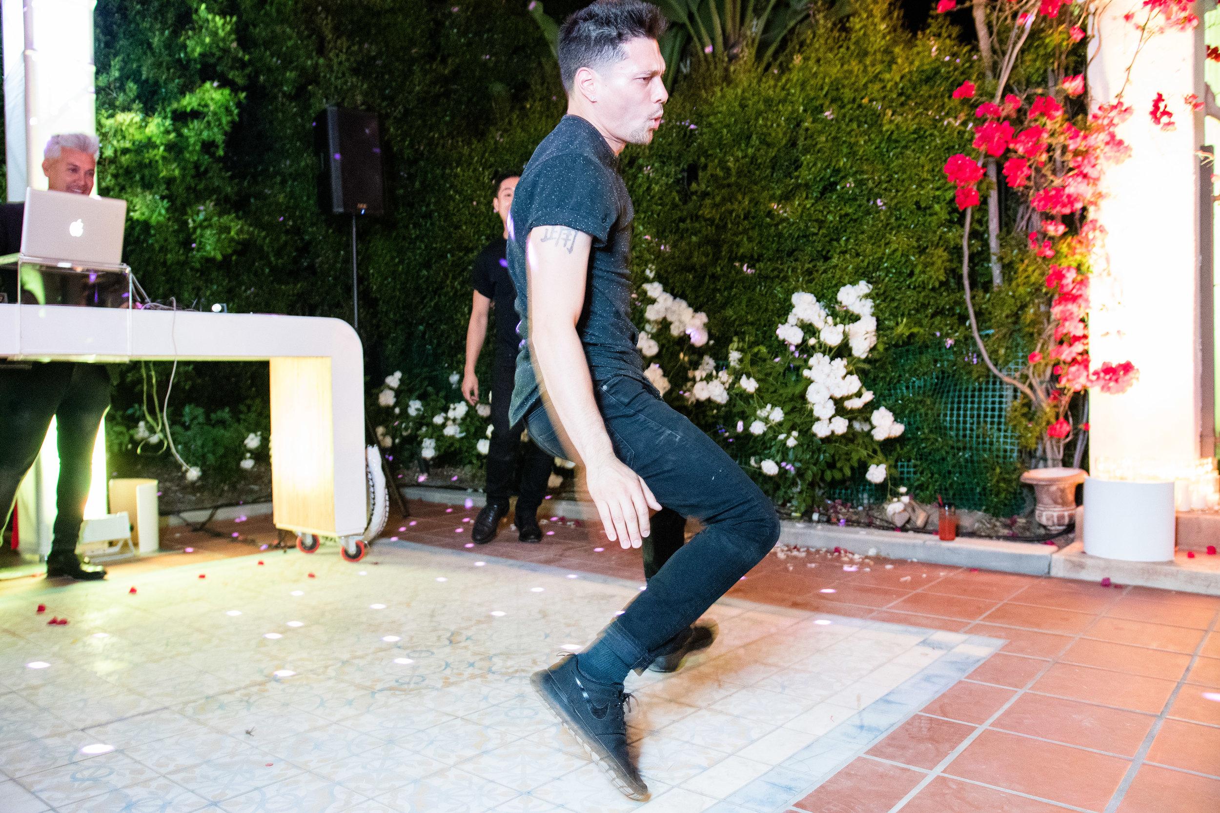 Vibrant Fiesta Backyard Wedding Reception break dancers wowing guests.jpg
