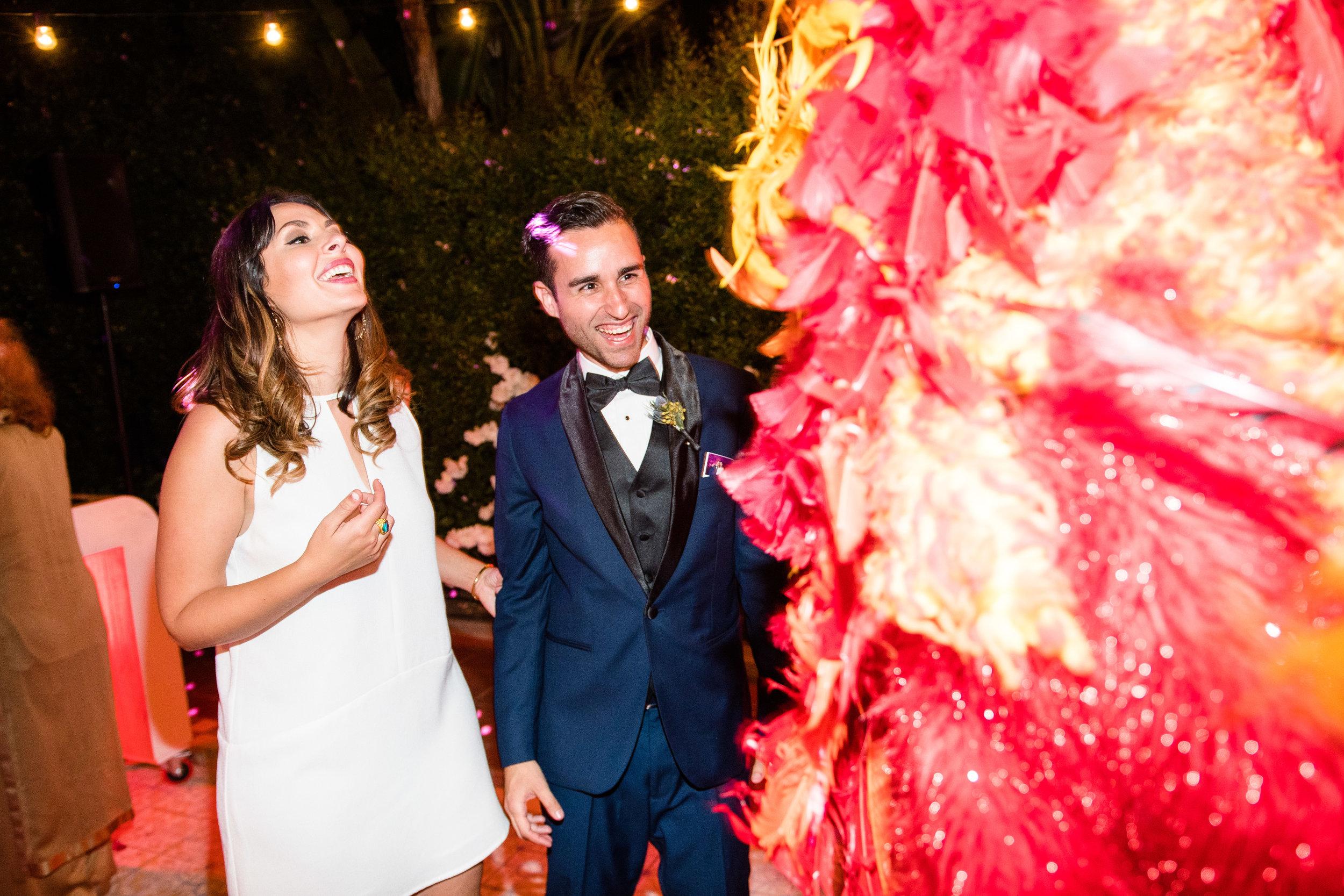 Vibrant Fiesta Backyard Wedding Reception bride and groom wiht miss fuego.jpg