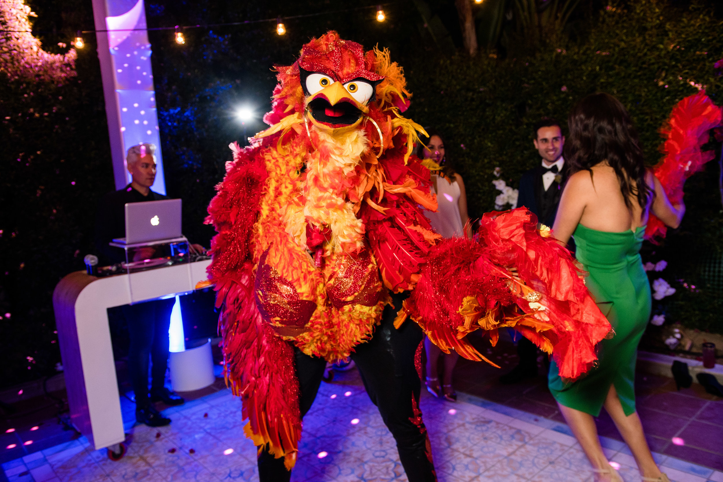 Vibrant Fiesta Backyard Wedding Reception miss fuego dancing with matron of honor.jpg