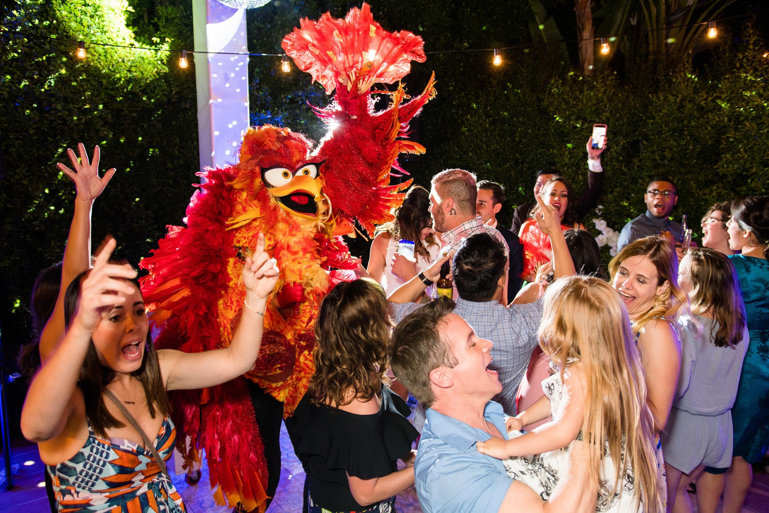Vibrant Fiesta Backyard Wedding Reception miss fuego dancing with guests.jpg