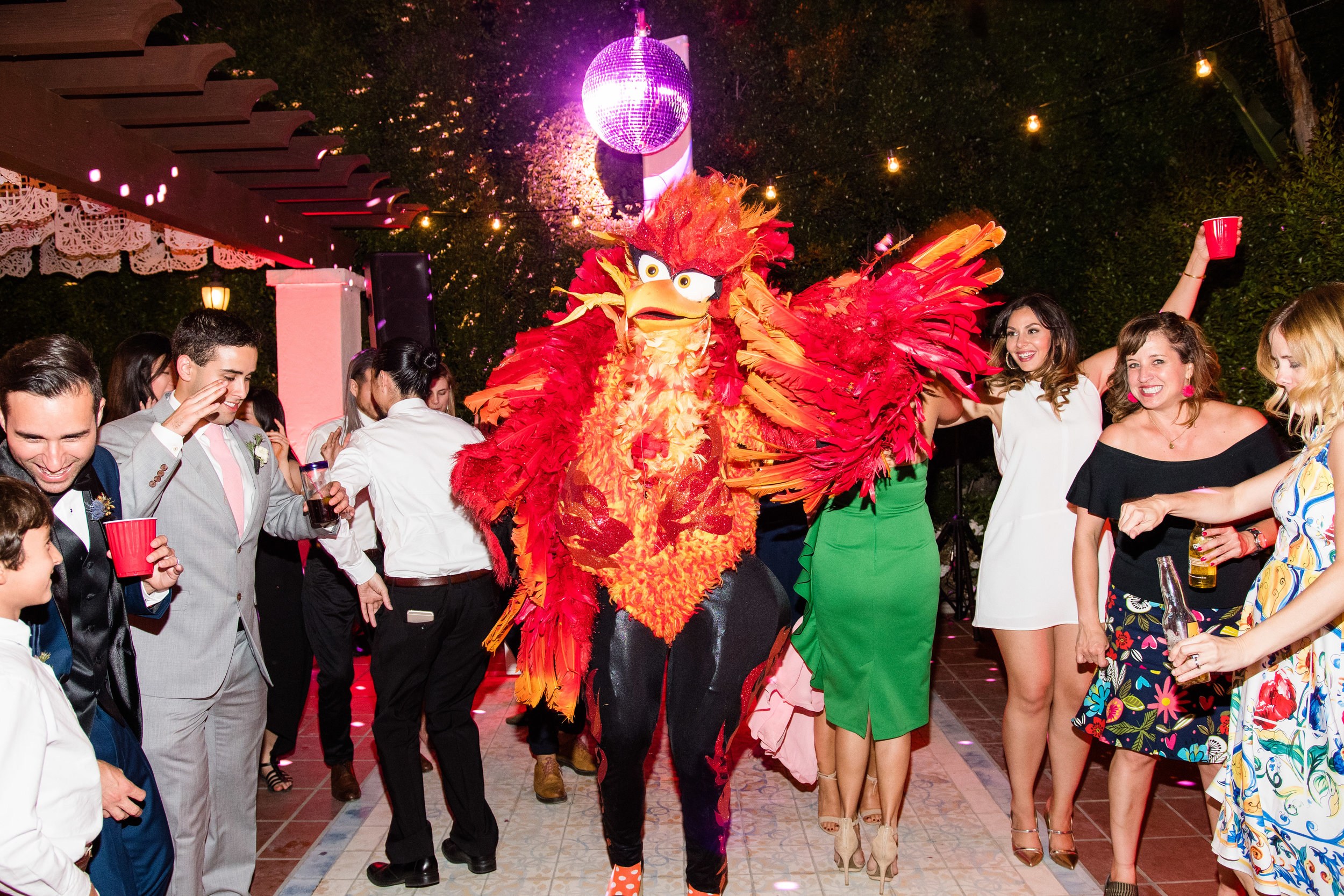 Vibrant Fiesta Backyard Wedding Reception miss fuego partying with guests.jpg