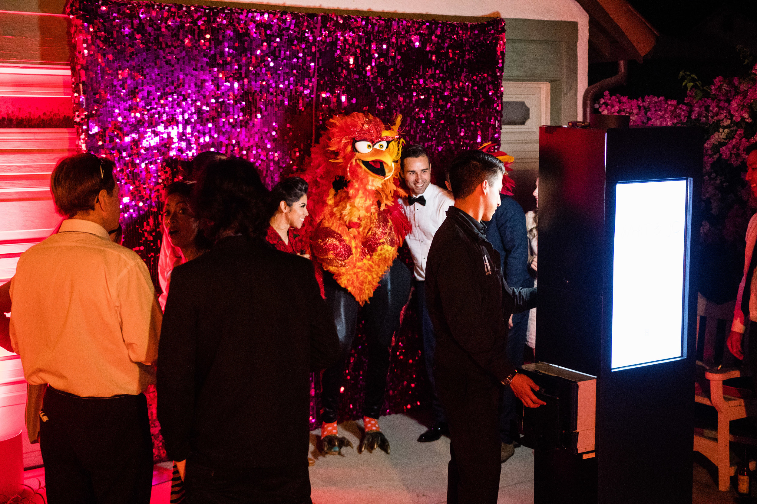 Vibrant Fiesta Backyard Wedding Reception miss fuego posing in photobooth.jpg