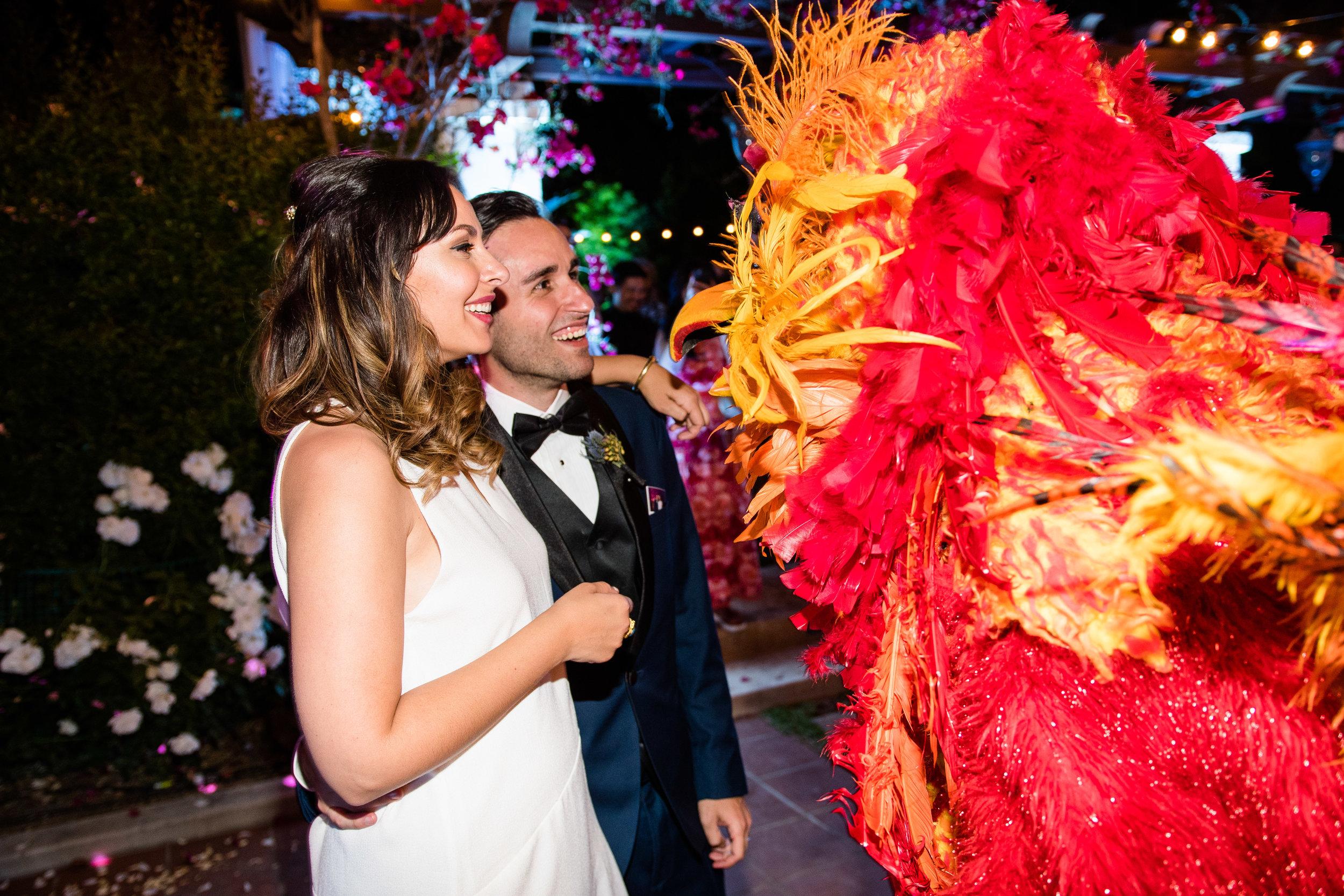 Vibrant Fiesta Backyard Wedding Reception miss fuego saying hi to bride and groom.jpg