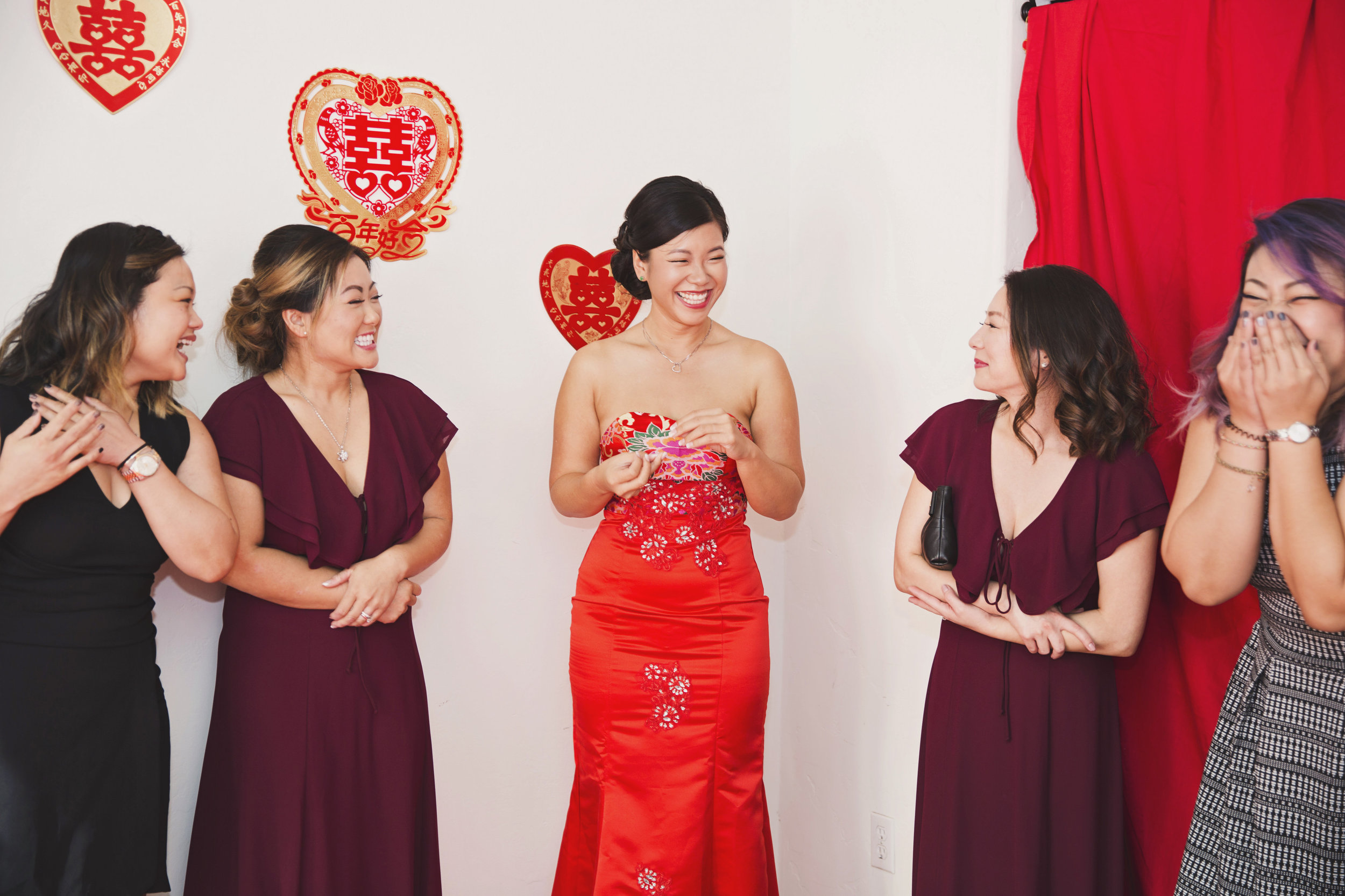 Beautiful Traditional Modern Chinese Wedding bride giggling with bridesmaids.jpg