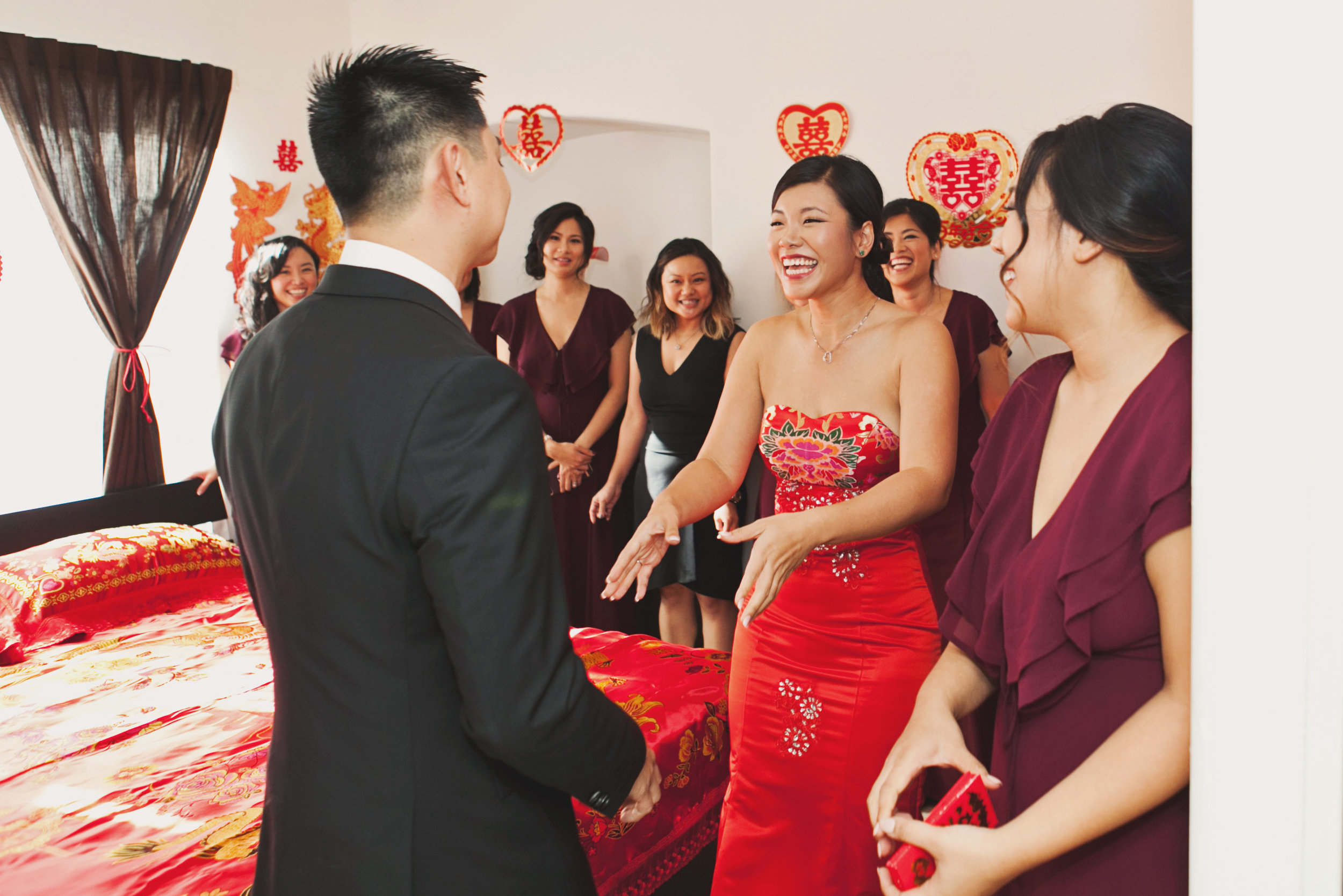 Beautiful Traditional Modern Chinese Wedding groom checks in on bride in nuptial suite.jpg