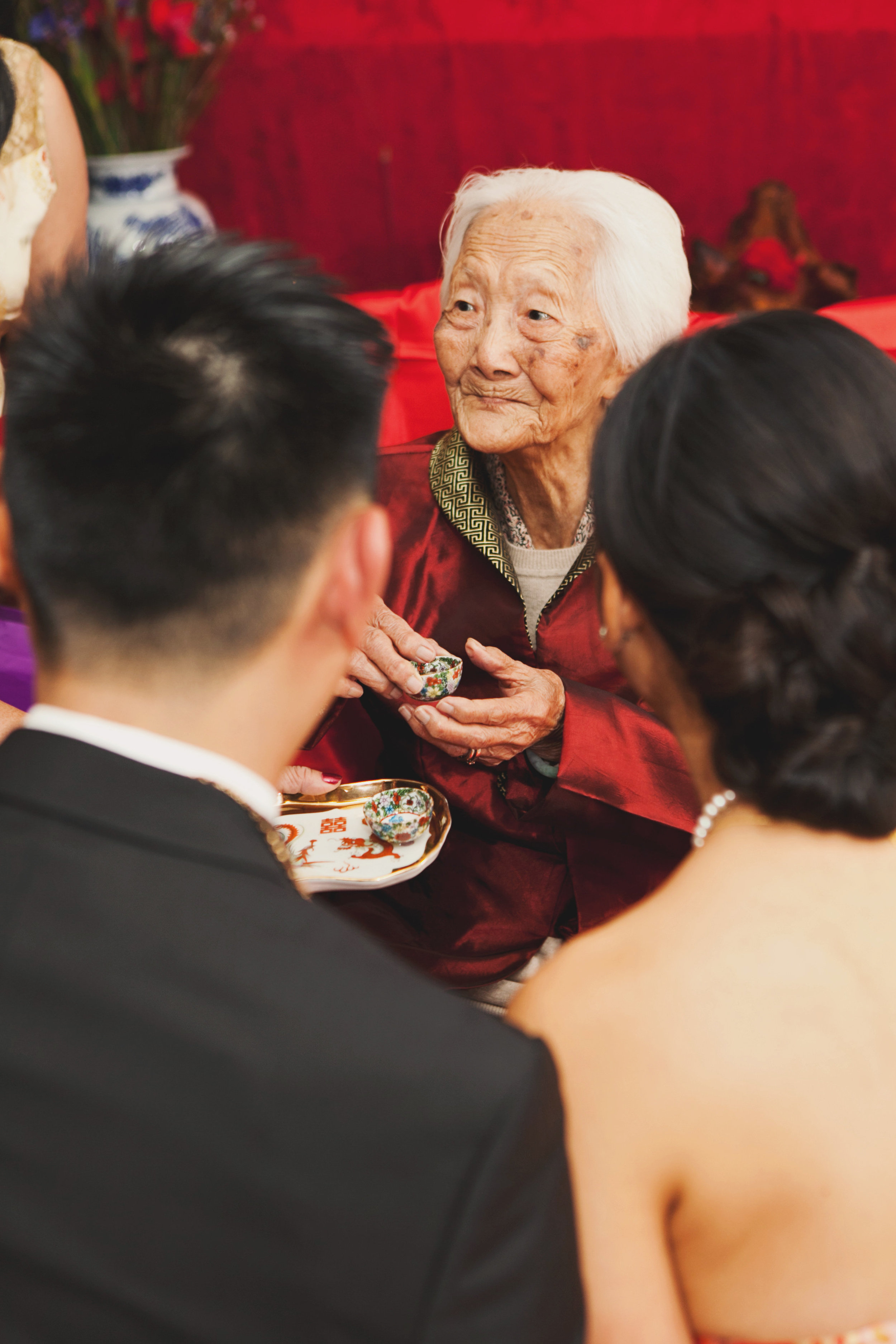 Beautiful Traditional Modern Chinese Wedding bride and groom drinking tea with grandmother .jpg