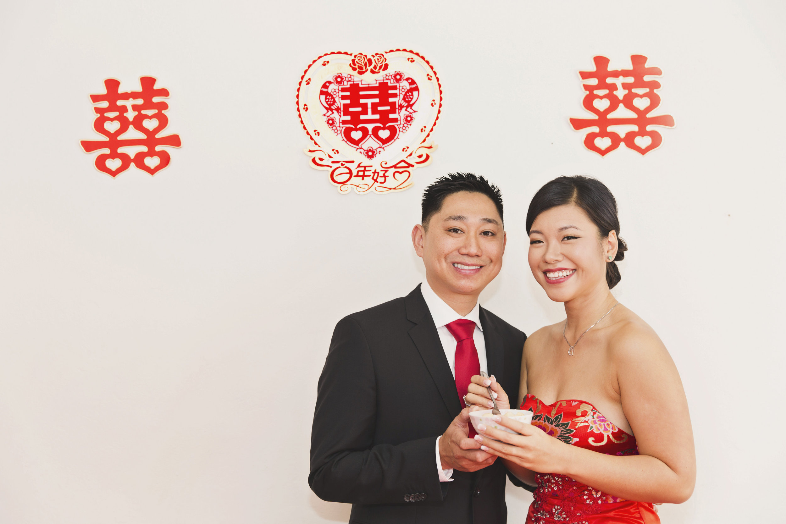 Beautiful Traditional Modern Chinese Wedding bride and groom share moment under double joy symbols.jpg