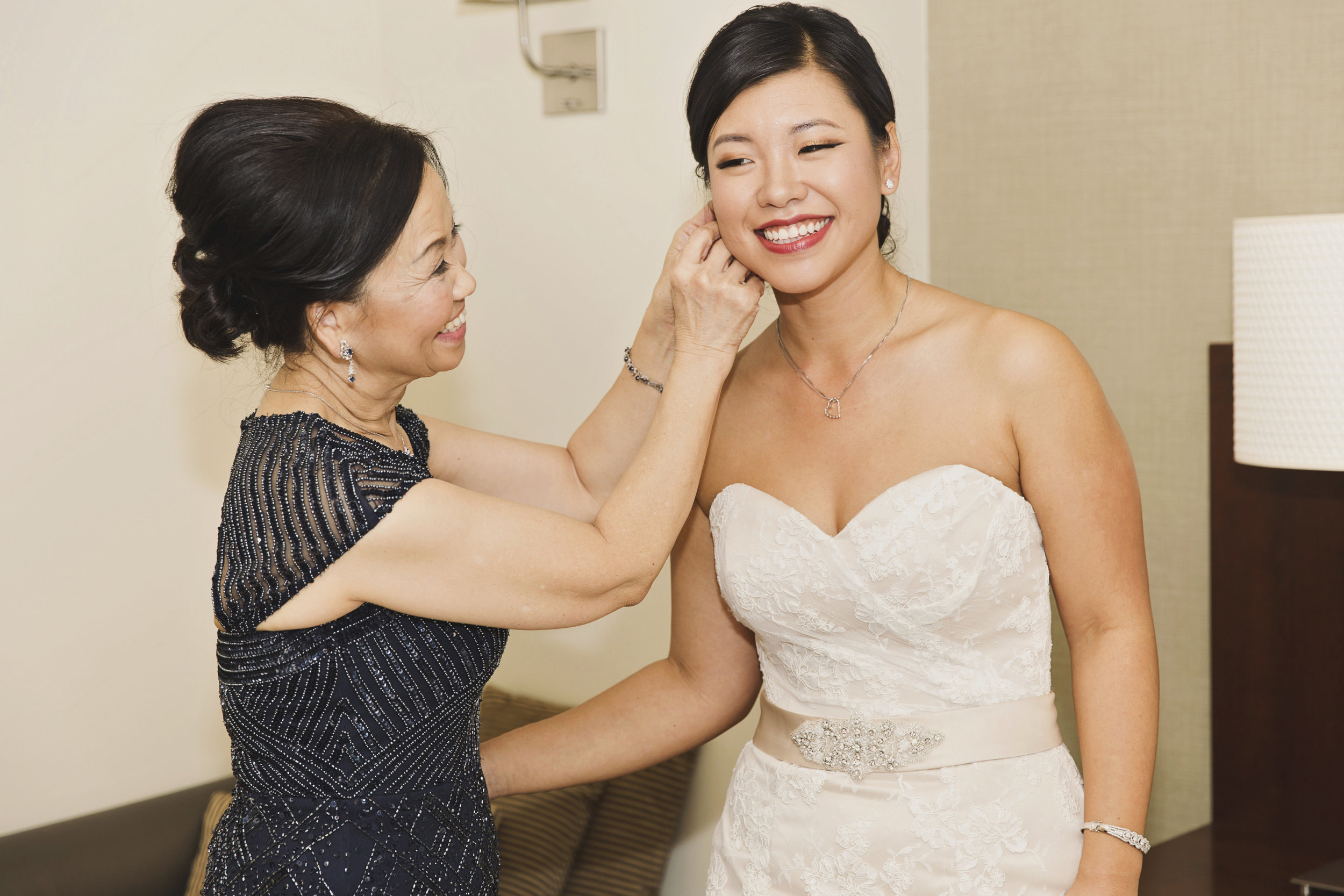 Beautiful Traditional Modern Chinese Wedding mother of the bride helps her get ready.jpg